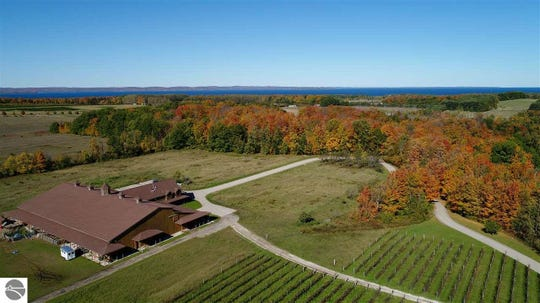 This $3.5 million American craftsman-style home north of Traverse City will enchant equestrian enthusiasts. Cradled by 48.53 acres of pastures and vineyards, the brick 12,374-square-foot home in Peninsula Township is about 330 yards from Prescott Lake and about 660 yards from the east arm of Grand Traverse Bay's Old Mission Harbor. In addition to its six bedrooms and seven bathrooms, the home has an indoor basketball court, a theater, a sauna and a marble steam room.
