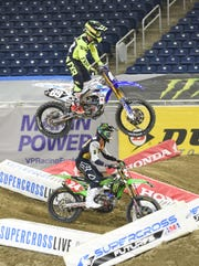 Supercross riders Joey Crown (89) and Austin Forkner (24) zoom down a custom track during a practice run Friday.