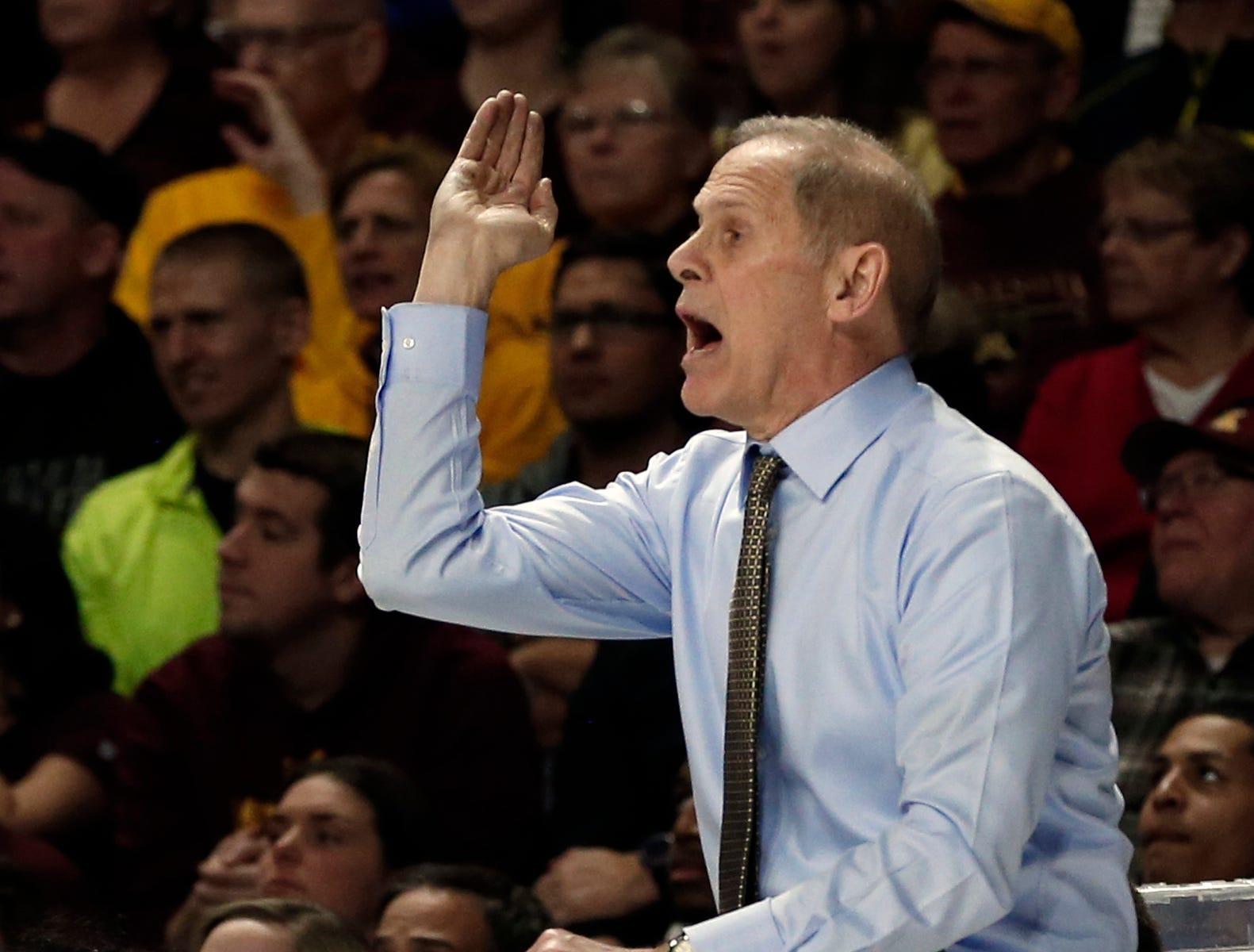 Michigan head coach John Beilein directs his team in the second half.
