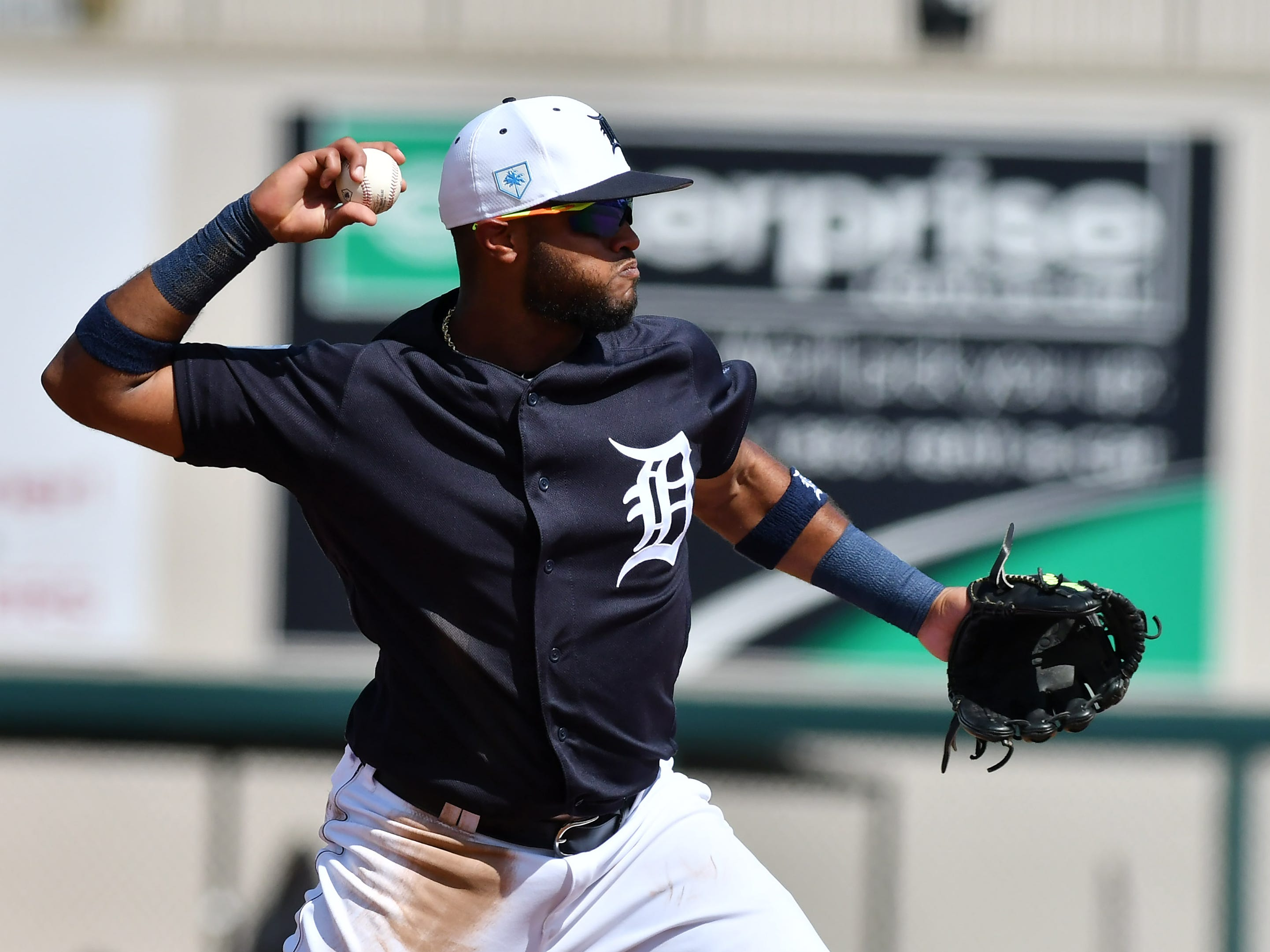 Tigers shortstop Willi Castro makes a throw to first in the third inning.