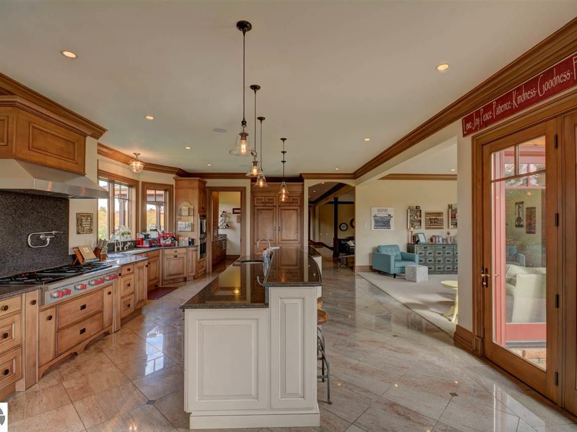 This $3.5 million American craftsman-style home north of Traverse Citywill enchant equestrian enthusiasts. Cradled by 48.53 acres of pastures and vineyards, the brick 12,374-square-foot home in Peninsula Township is about330 yards from Prescott Lake and about 660 yards from the east arm of Grand Traverse Bay's Old Mission Harbor. In addition to its six bedrooms and seven bathrooms, the home has an indoor basketball court, a theater, a sauna and a marble steam room.