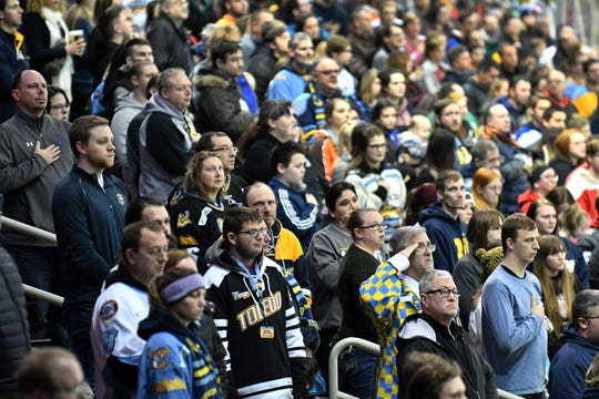 Fans stand during the national anthem before a game Jan. 31 between the Toledo Walleye and Kalamazoo Wings at the Huntington Center in Toledo, Ohio.