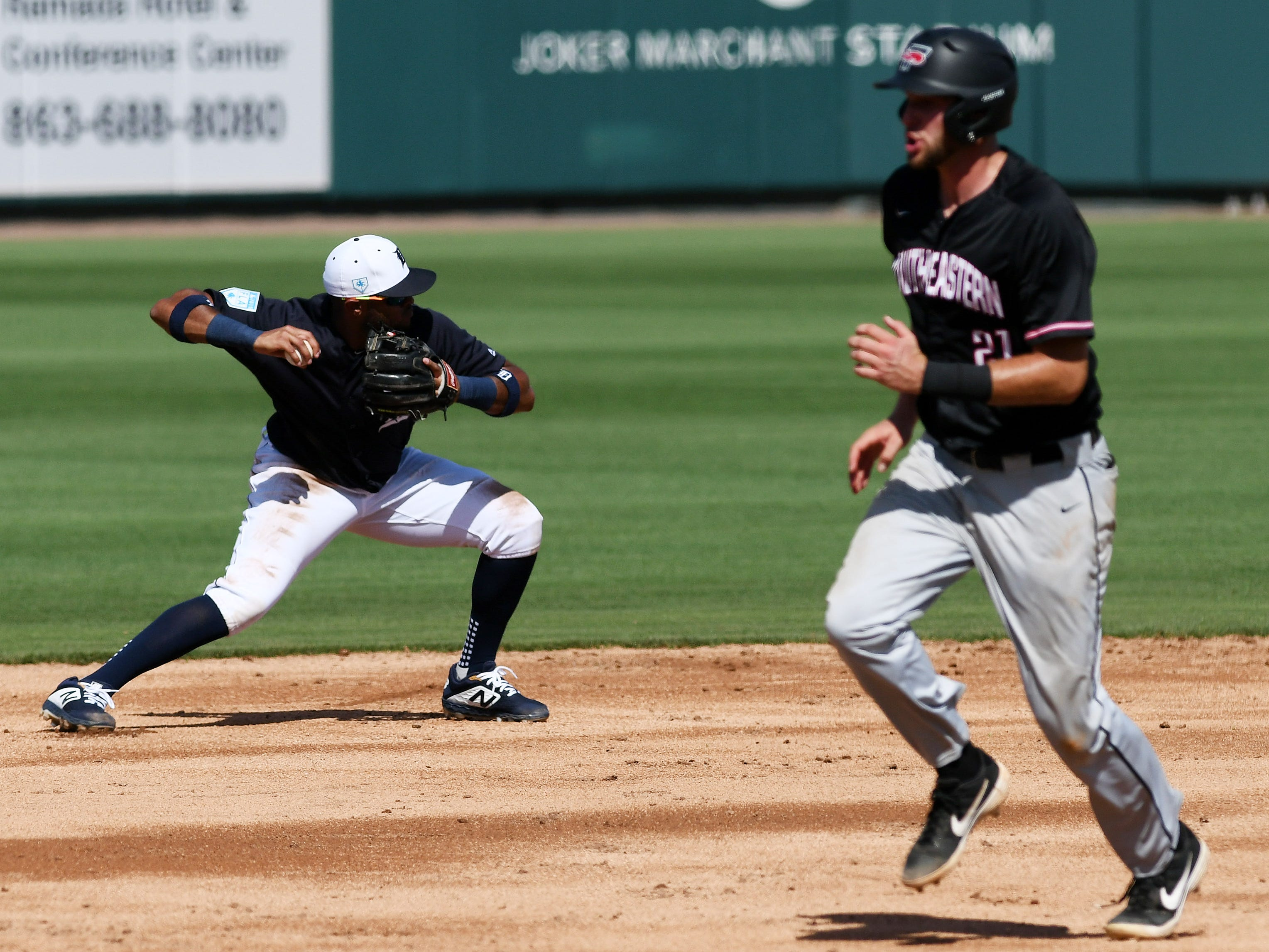 Tigers shortstop Willi Castro throws to second base in the fourth inning.