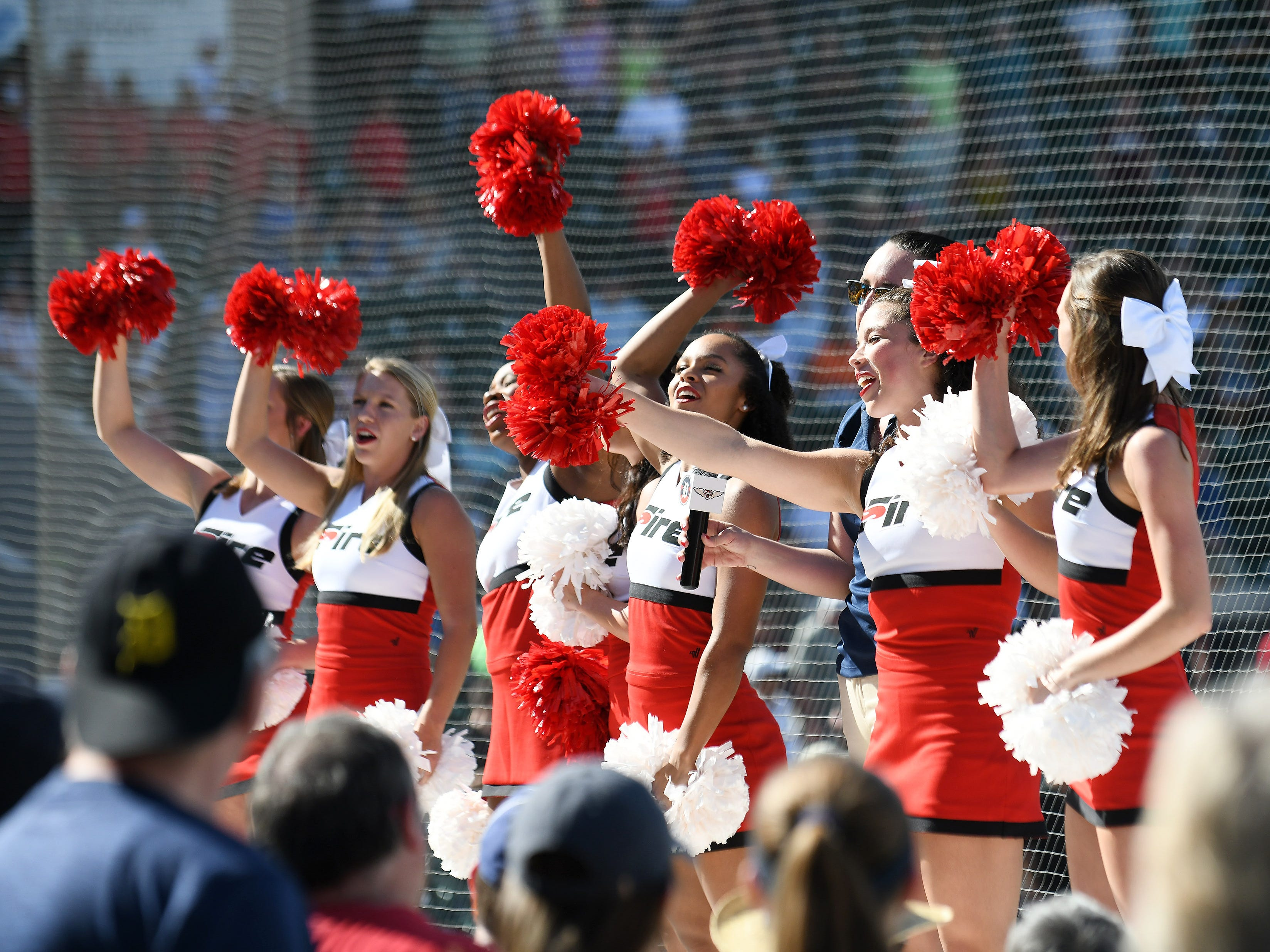 Southeastern University cheerleaders help lead the fans in singing 'Take me out to the ballgame' during the seventh inning stretch.