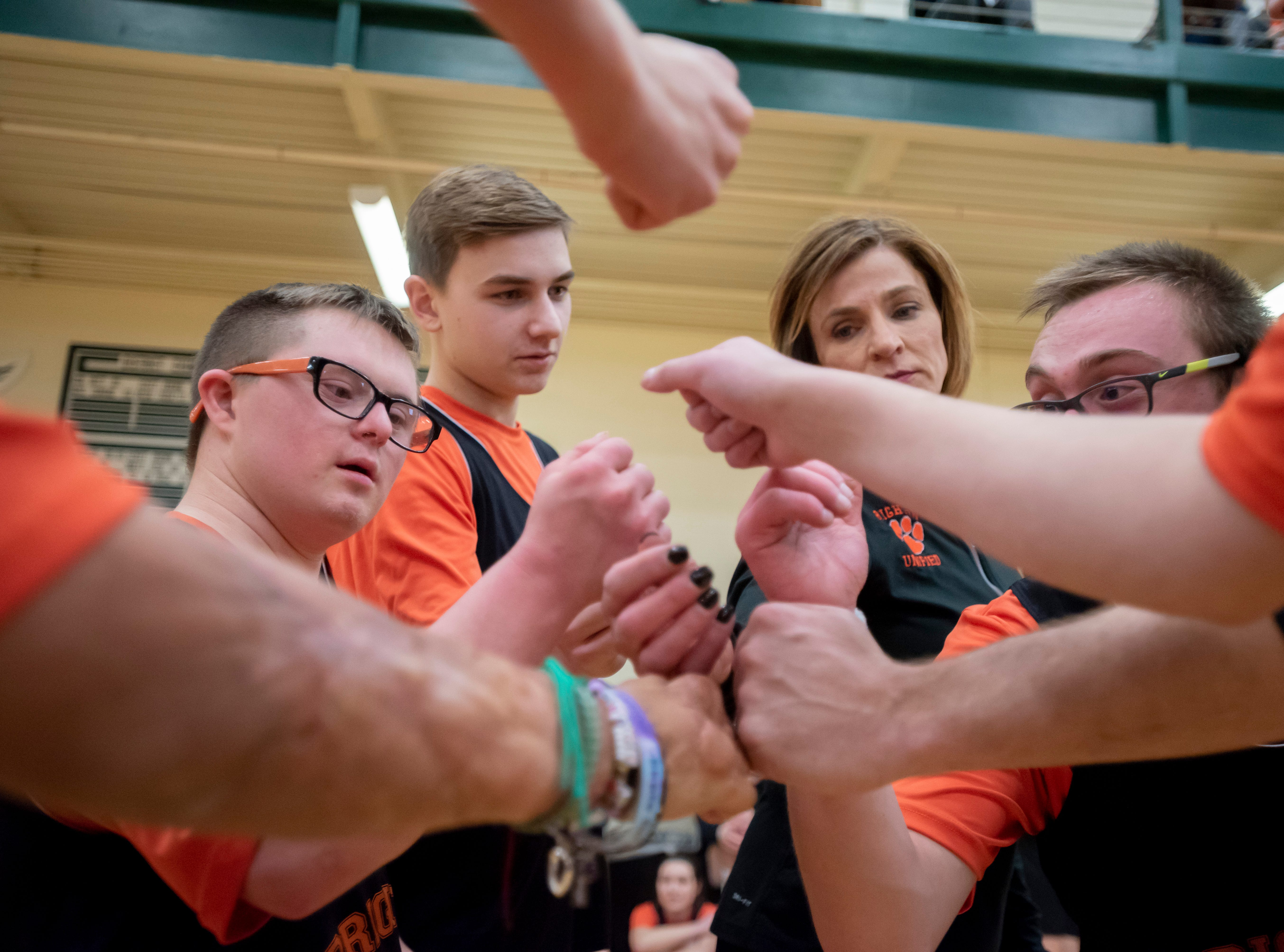 Brighton Unified pump themselves up during the Kensington Lakes Athletic Association Unified basketball tournament at Novi high school.