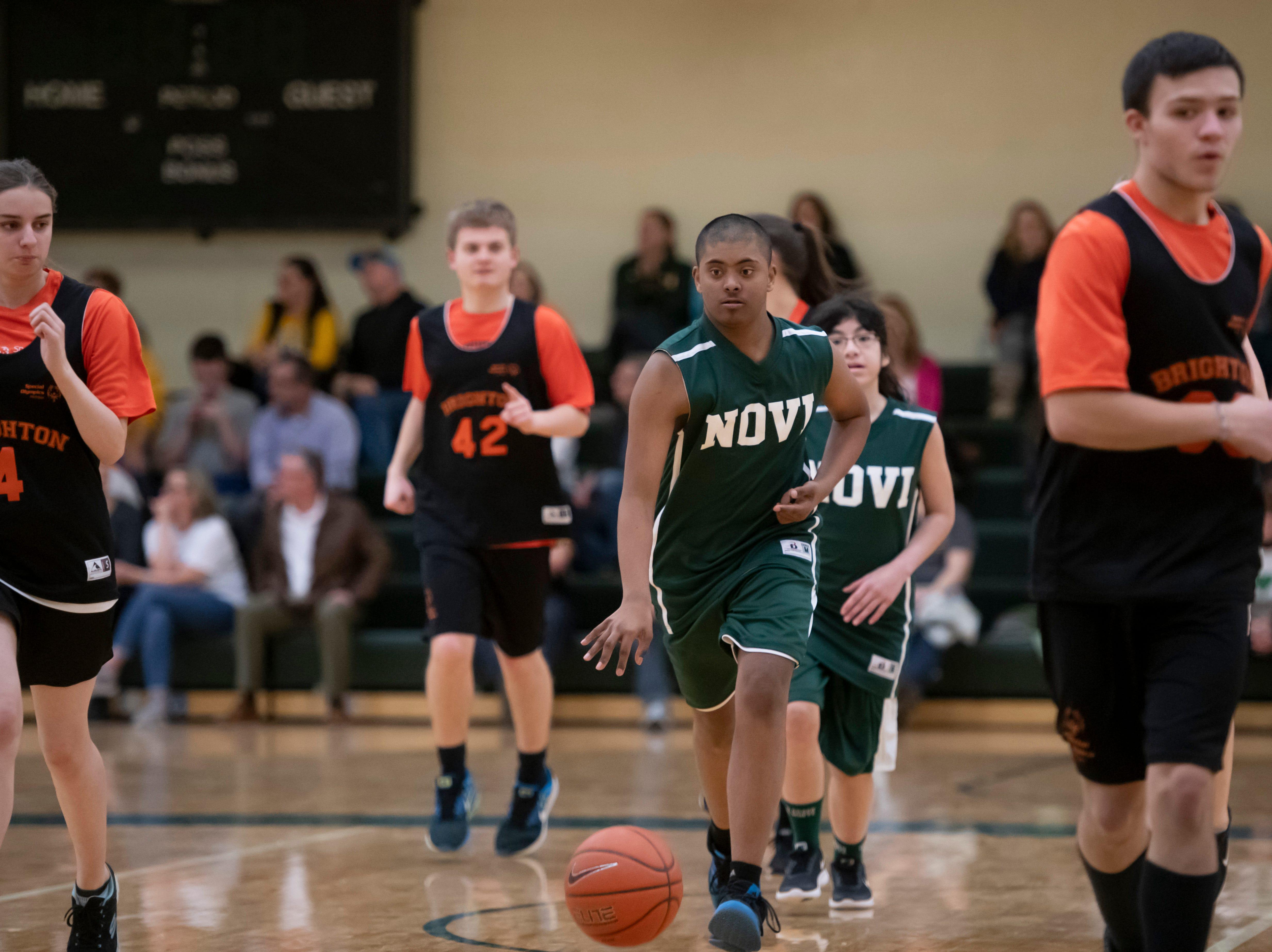 Novi's Sujay Kolli runs the ball up the court against Brighton during the Kensington Lakes Athletic Association Unified basketball tournament at Novi high school.