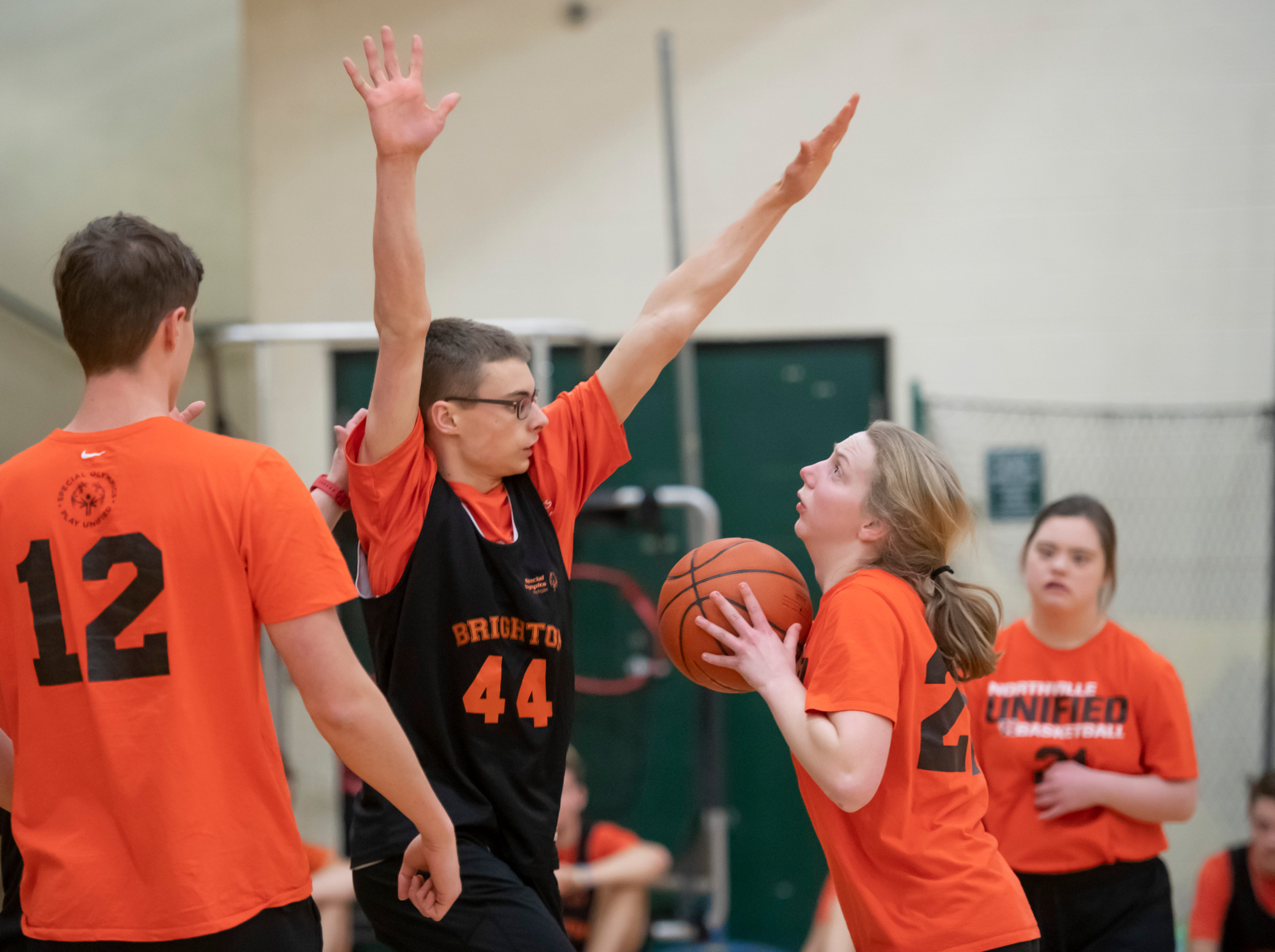 Brighton's Zach Thomas defends against Northville Unified's Jane Colter during the Kensington Lakes Athletic Association Unified basketball tournament at Novi high school, February 21, 2019. The co-ed games have teams of players with and without disabilities.