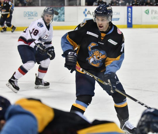 Toledo forward Tyler Spezia (7) comes over to the corner to assist a teammate in the second period of game Jan. 31 against the Kalamazoo Wings at the Huntington Center in Toledo, Ohio.