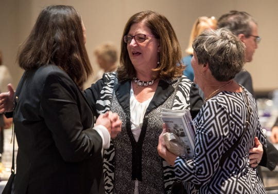 Long time friends Carol Schaefer, left, and Colleen McLaughlin congratulated Susan Parsons after she accepted the 2019 ATHENA award Friday, Feb. 22, 2019.