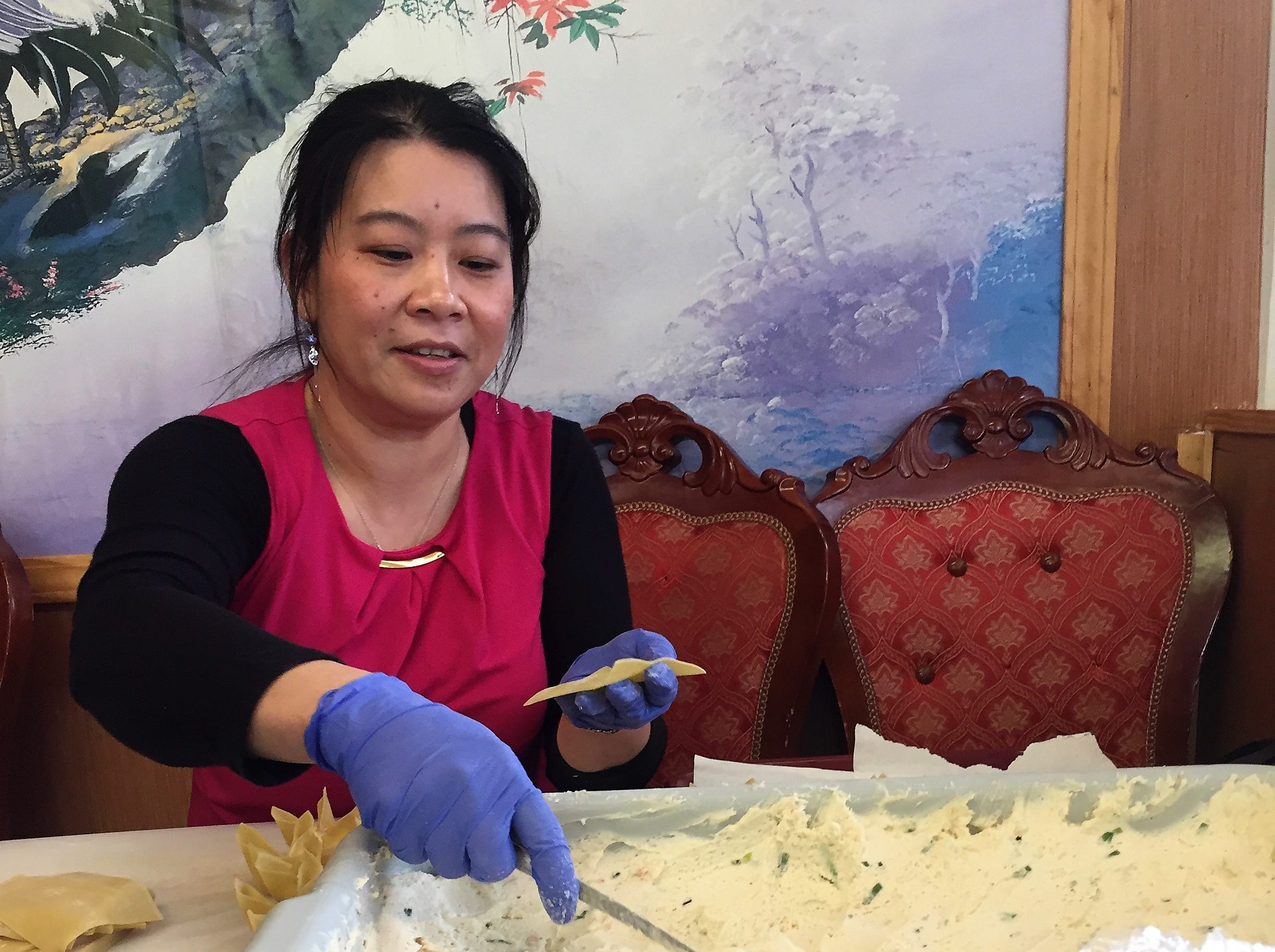 Xue Ying of Yum Yum Chinese Restaurant in Henderson mixes filling and hand-folds hundreds upon hundreds of crab rangoon every week.