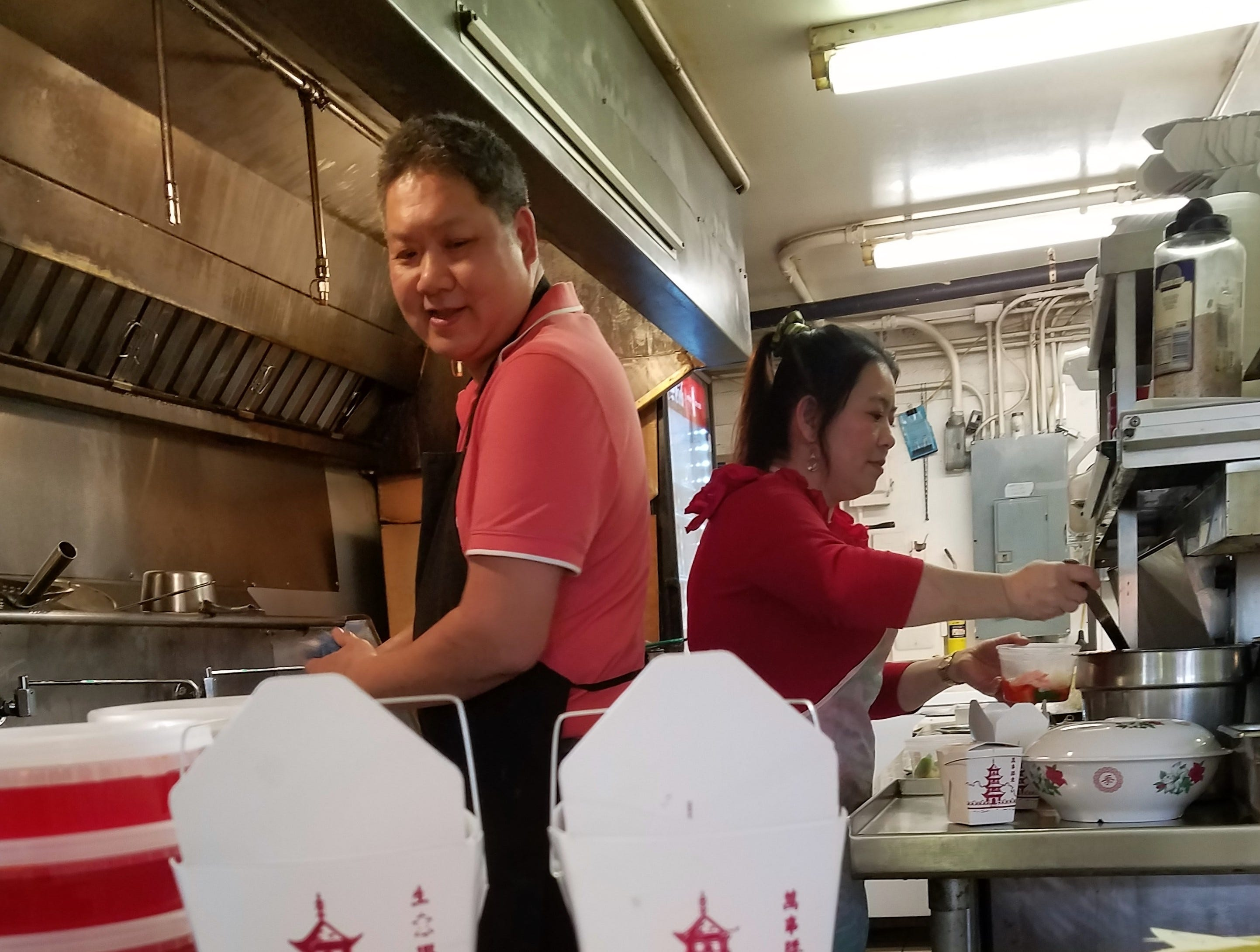 Phillip Mah and Xue Ying doing what they love--working in the kitchen at Yum Yum Chinese Restaurant in Henderson.