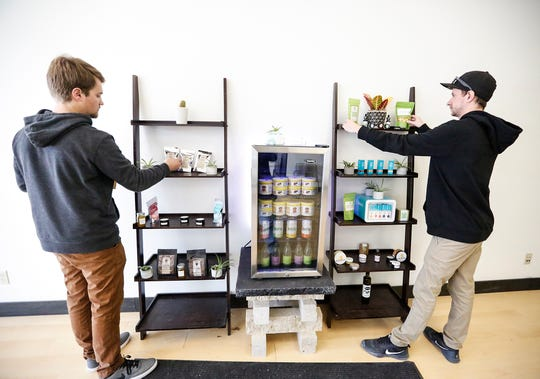 HempWorks Wisconsin co-owners and co-founders Ben Mueller and Matt Wirtz put a display together Feb. 22 as they get ready to open their store, which will sell hemp and CBD products, on March 1.