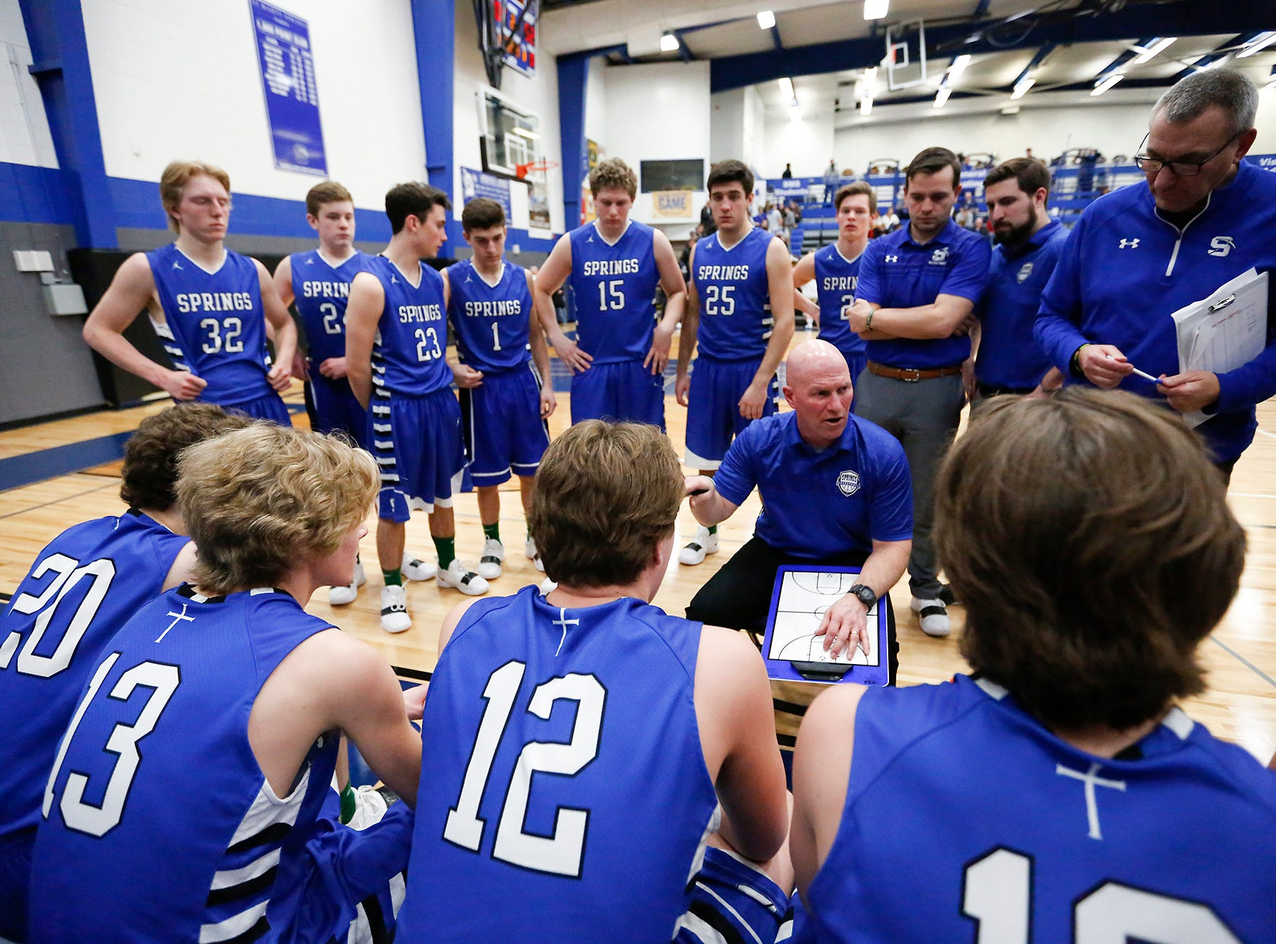 St Mary's Springs Academy boys basketball coach Kyle Krueger talks with his team during a time out from their game against Winnebago Lutheran Academy Thursday, February 21, 2019 in Fond du Lac, Wisconsin. Winnebago Lutheran Academy won the game 95-86. Doug Raflik/USA TODAY NETWORK-Wisconsin