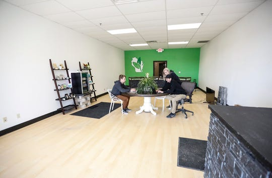 HempWorks Wisconsin co-owners and co-founders Ben Mueller and Matt Wirtz, as well as store manager Natasha Timm, work on their computers Feb. 22, as they get ready to open the store located at 188 N. Main St. in Fond du Lac. The store, which will sell hemp and CBD products, is set to open March 1.