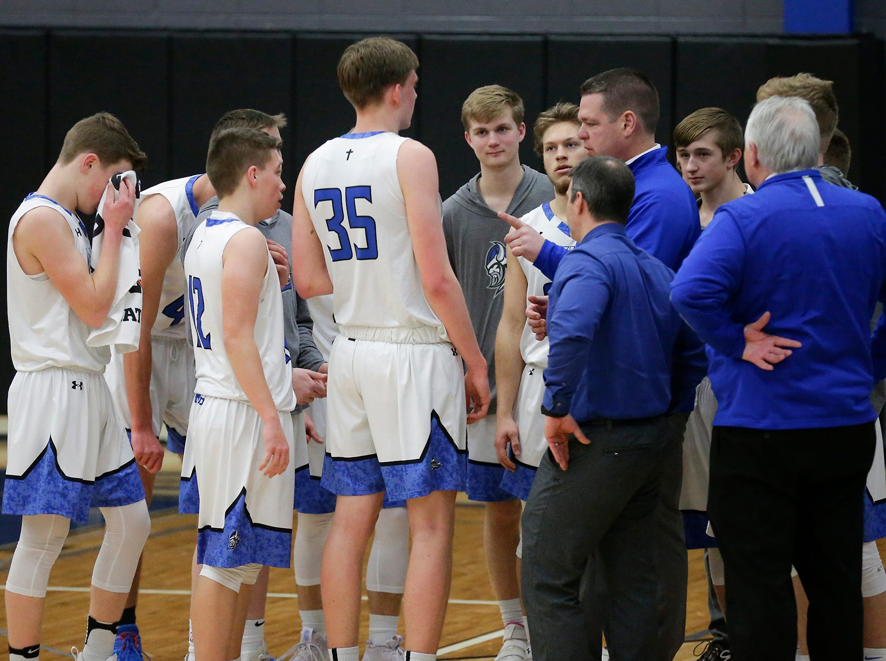 Winnebago Lutheran Academy boys basketball's head coach Marty Nell talks to his team during a time out during their game against St Mary's Springs Academy Thursday, February 21, 2019 in Fond du Lac, Wisconsin. Winnebago Lutheran Academy won the game 95-86. Doug Raflik/USA TODAY NETWORK-Wisconsin