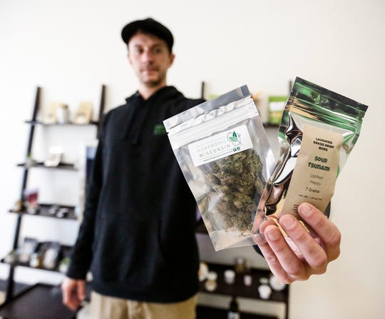 HempWorks Wisconsin co-owner and co-founder Matt Wirtz holds up some store merchandise at the store located at 188 N. Main St. in Fond du Lac.