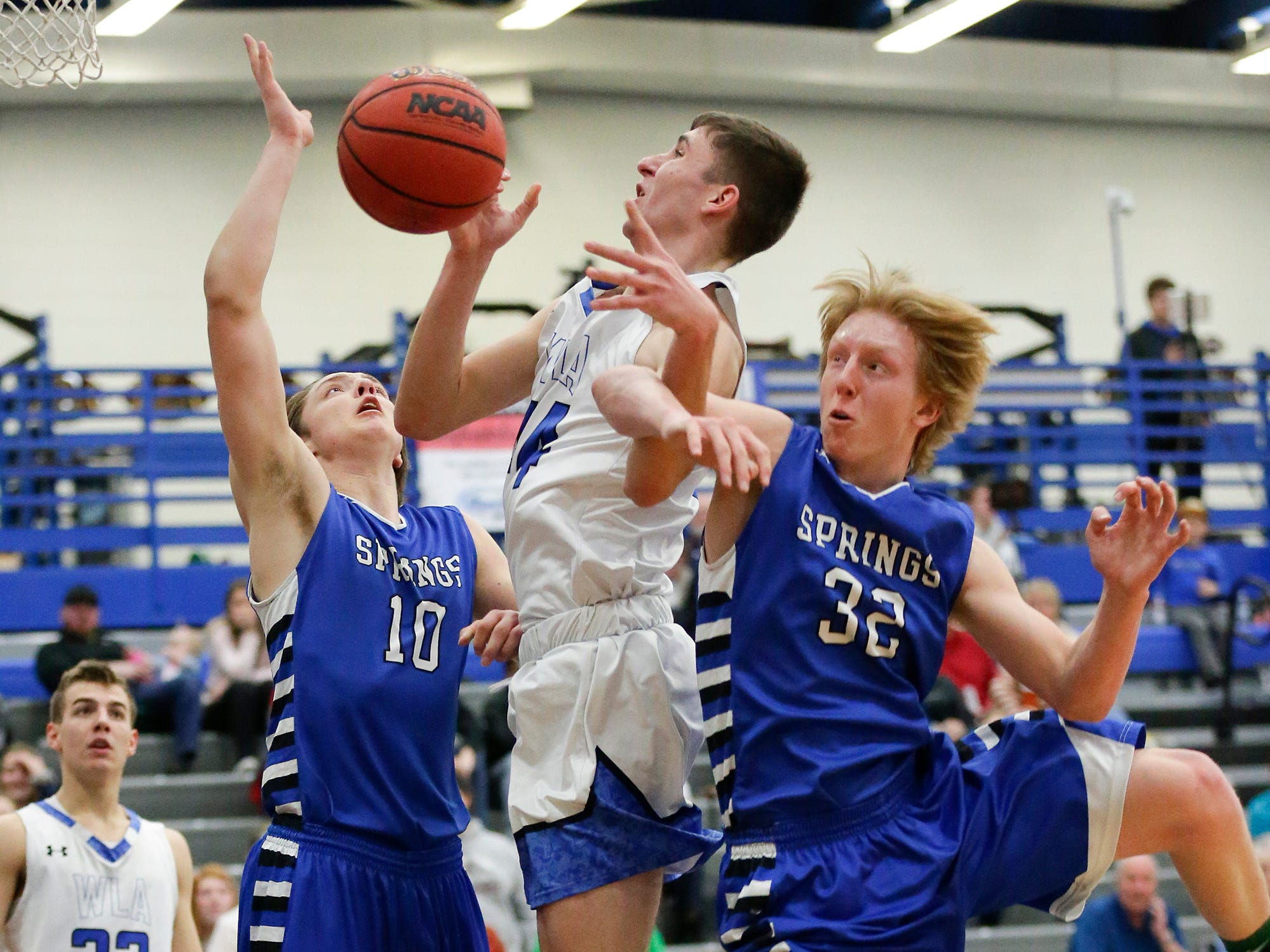 Winnebago Lutheran Academy boys basketball's Benji Cole (44) is fouled by St Mary's Springs Academy's Ezra Tucker (32) during their game Thursday, February 21, 2019 in Fond du Lac, Wisconsin. Winnebago Lutheran Academy won the game 95-86. Doug Raflik/USA TODAY NETWORK-Wisconsin