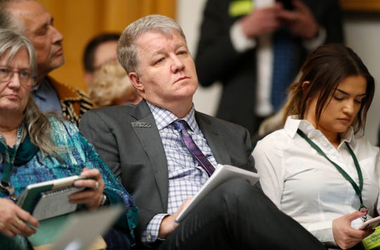"""Dudley Brown, a gun right lobbyist and founder and executive director of Rocky Mountain Gun Owners, listens to testimony during a hearing before the House Judiciary Committee on a bill to get a """"red flag"""" gun law on the books in Colorado Thursday, Feb. 21, 2019, in Denver. The bill, which is backed by several law enforcement officials, would allow for the seizure of weapons from persons deemed by a court to pose a significant risk to themselves and to others. (AP Photo/David Zalubowski)"""