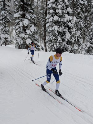 Poudre School District skiers Bryce Pfuetze, left, and Andrew Feist compete in the boys 5-kilometer classic cross-country race Thursday at the state championships at Purgatory Resort near Durango.
