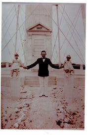 Principal lighthouse Osmund McKinney with his daughters