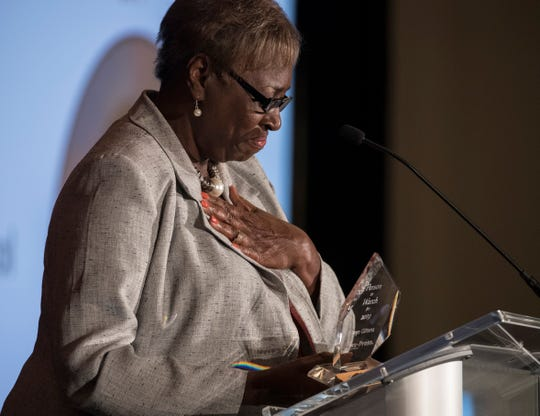 Gwinn Gittens,with the Lee County School Board, becomes emotional after receiving the 2019 Person to Watch award during Friday's People of the Year event in Cape Coral.