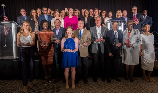 The category winners for the People of The Year awards gather for a group photo after the event's completion Friday, February 22, 2019.