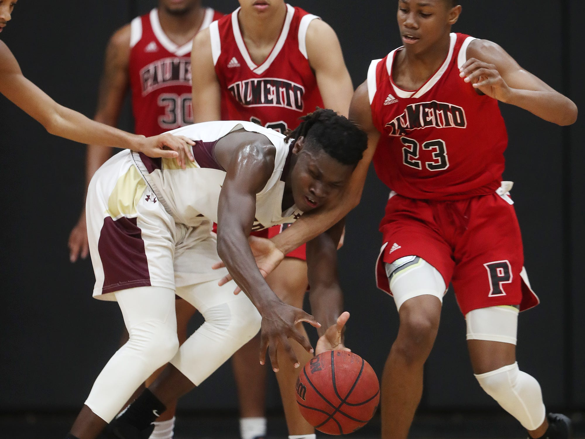 Riverdale High School's Keyshawn Rowe hustles for a loose ball against Palmetto on Thursday in the Class 8A regional quarterfinal at Riverdale in Fort Myers. Riverdale beat Palmetto 61-54.