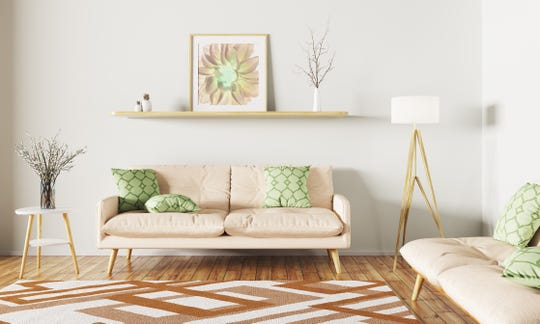 "For 2019, the color trends are all about bringing the outside in, with bright pops of coral, rich greens and a new twist on an old favorite sometimes called ""mushroom gray."""