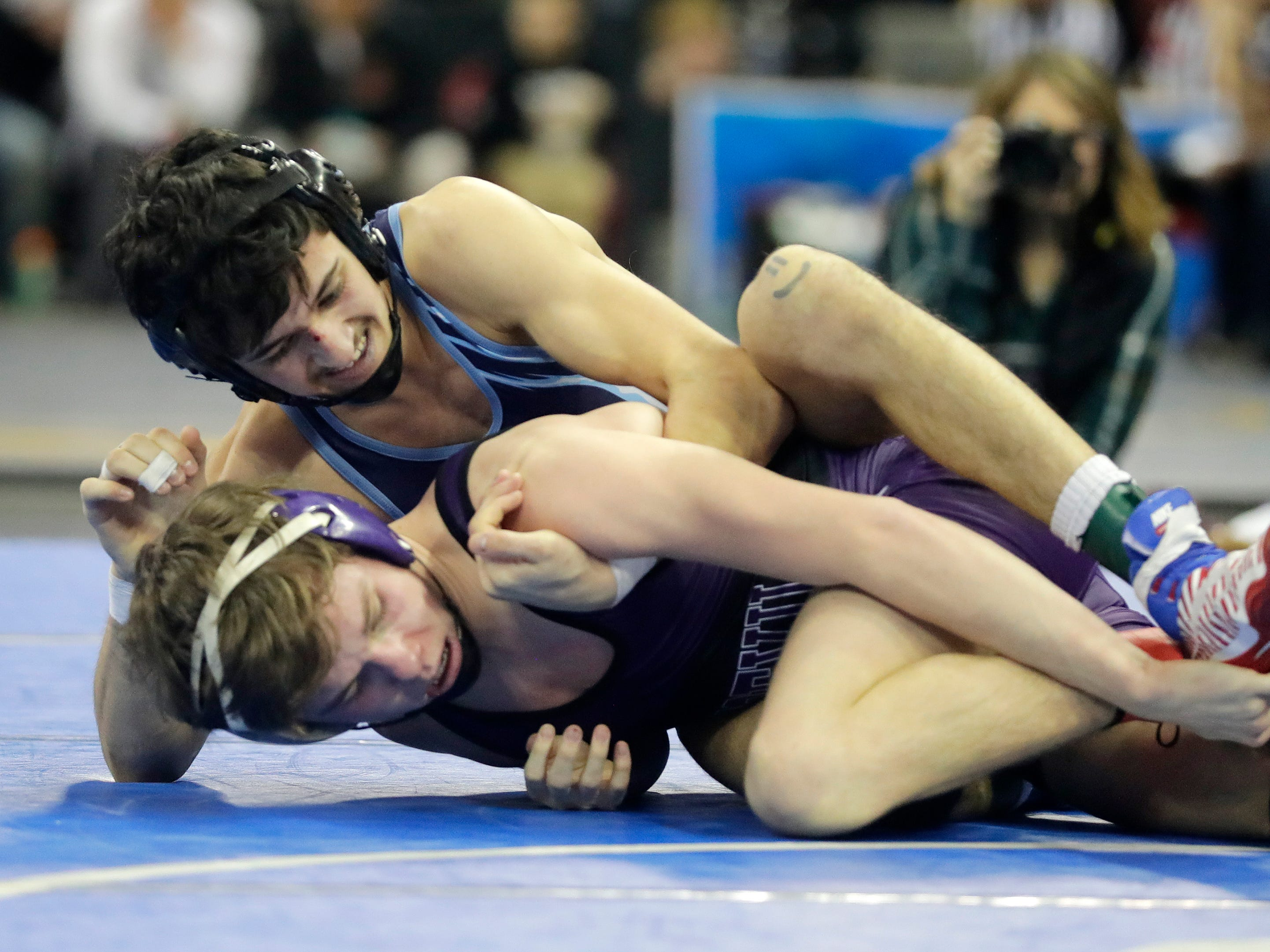 Florence/Niagara's Tristen Mascarette wrestles Boyceville's Nate Stuart in a Division 3 120-pound preliminary match at the WIAA state individual wrestling tournament at the Kohl Center on Thursday, February 21, 2019 in Madison, Wis.