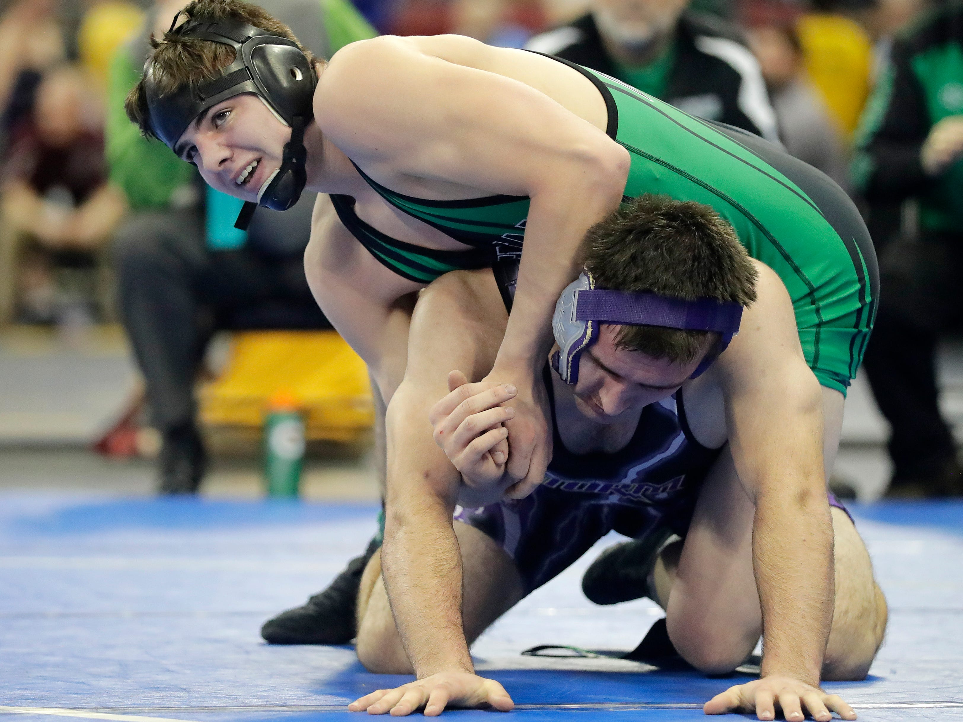 Coleman's Shamus McLain wrestles Kewaunee's Travis Reinke in a Division 3 170-pound preliminary match at the WIAA state individual wrestling tournament at the Kohl Center on Thursday, February 21, 2019 in Madison, Wis.
