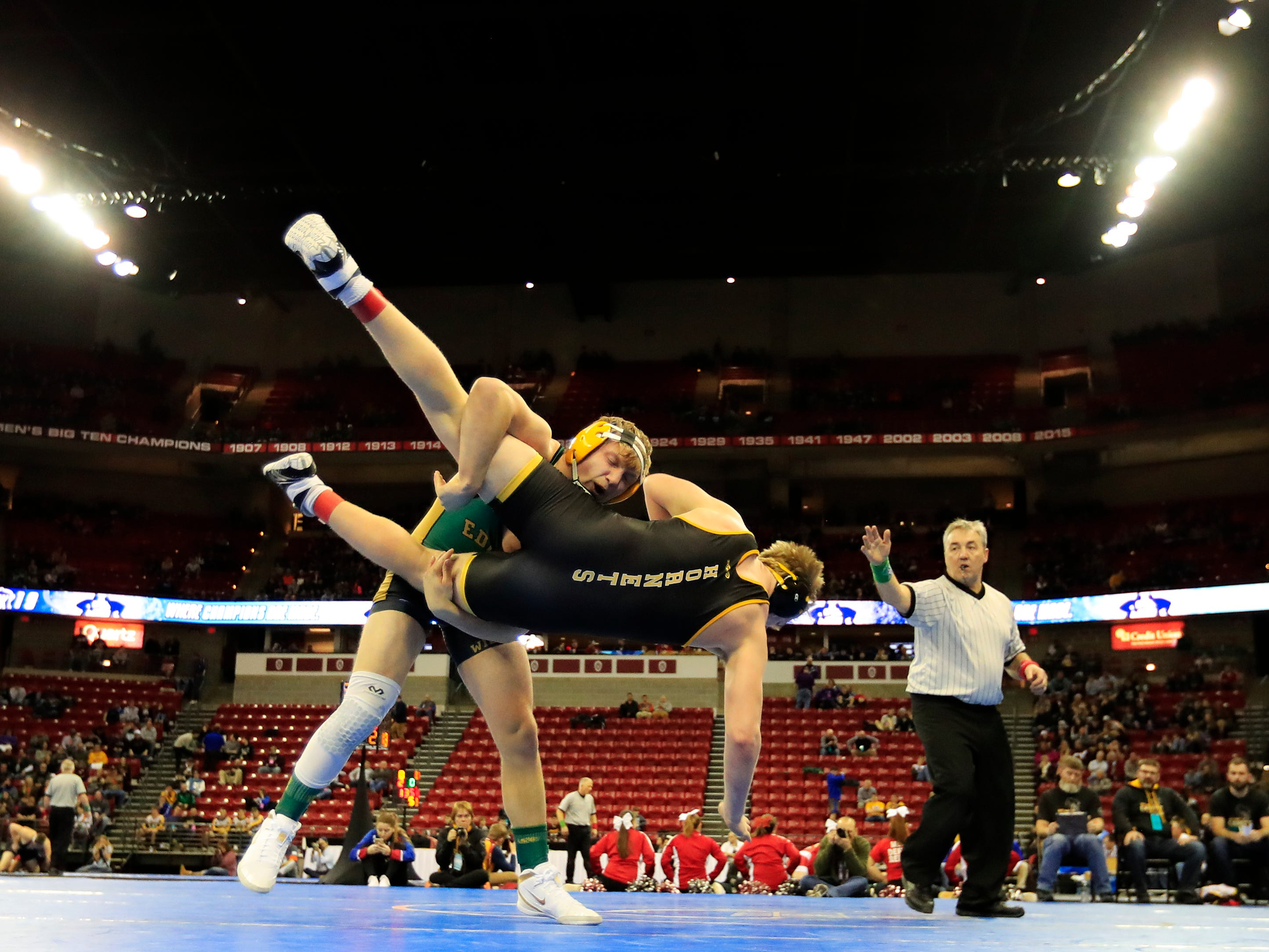 Edgar's William Raatz gets a takedown in a Division 3 195-pound preliminary match at the WIAA state individual wrestling tournament at the Kohl Center on Thursday, February 21, 2019 in Madison, Wis.