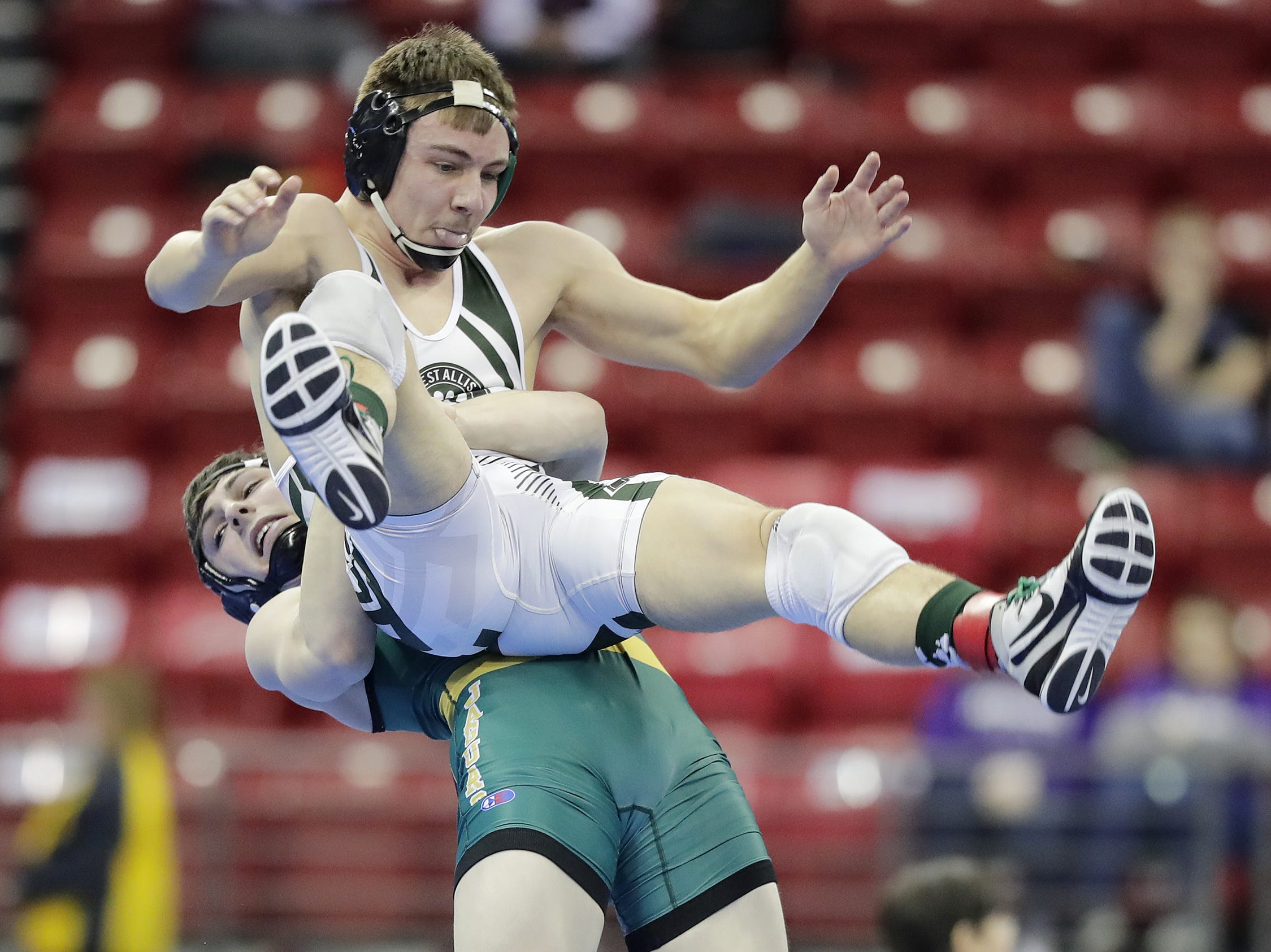 Ashwaubenon's Connor Ramage takes down West Allis/Nathan Hale's Cody Kibler in a Division 1 160-pound preliminary match at the WIAA state individual wrestling tournament at the Kohl Center on Thursday, February 21, 2019 in Madison, Wis. Adam Wesley/USA TODAY NETWORK-Wisconsin