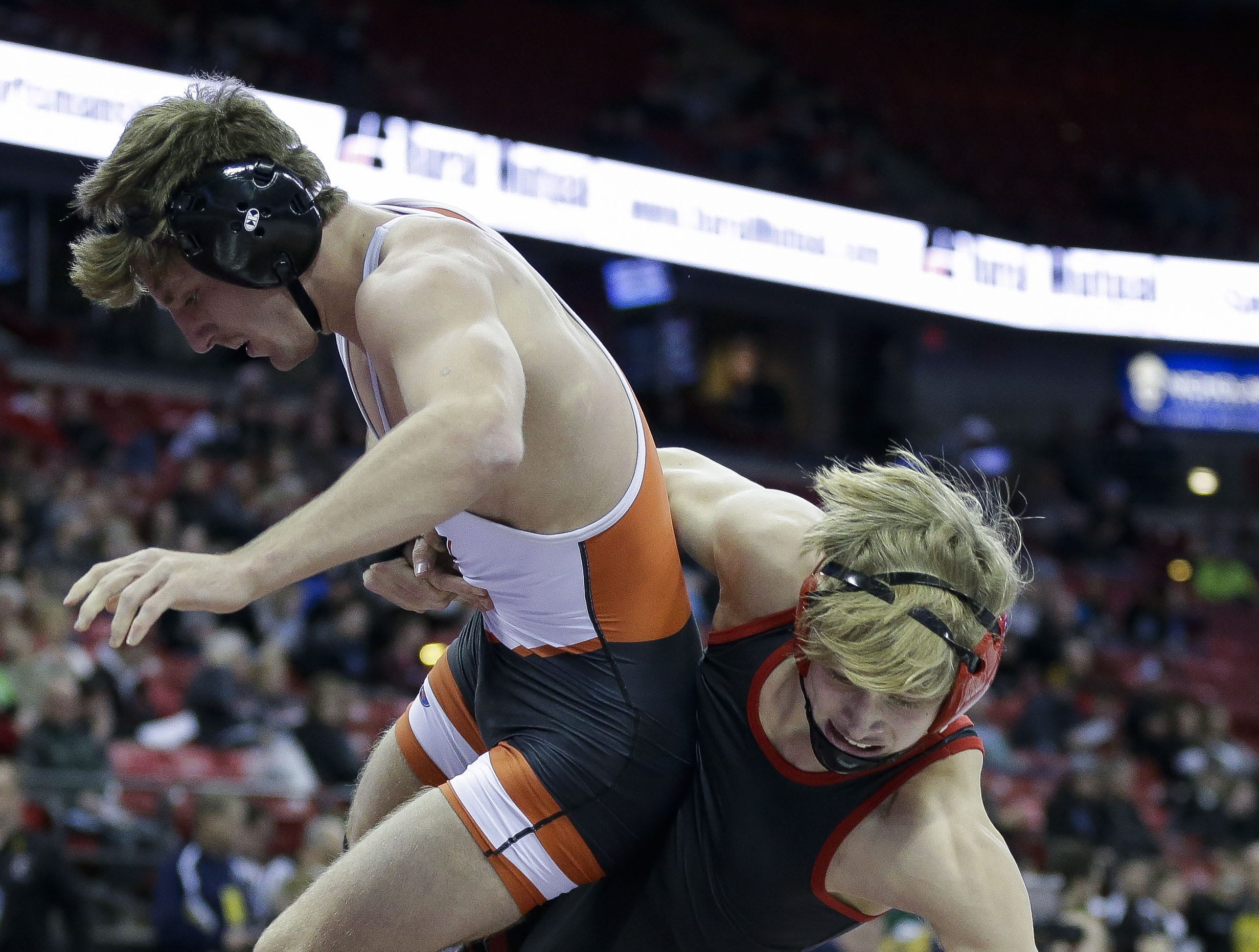 Kimberly's Tucker Smith takes down Marshfield's Caden Pearce out of bounds in a Division 1 145-pound preliminary match during the WIAA state wrestling tournament on Thursday, February 21, 2019, at the Kohl Center in Madison, Wis. Tork Mason/USA TODAY NETWORK-Wisconsin