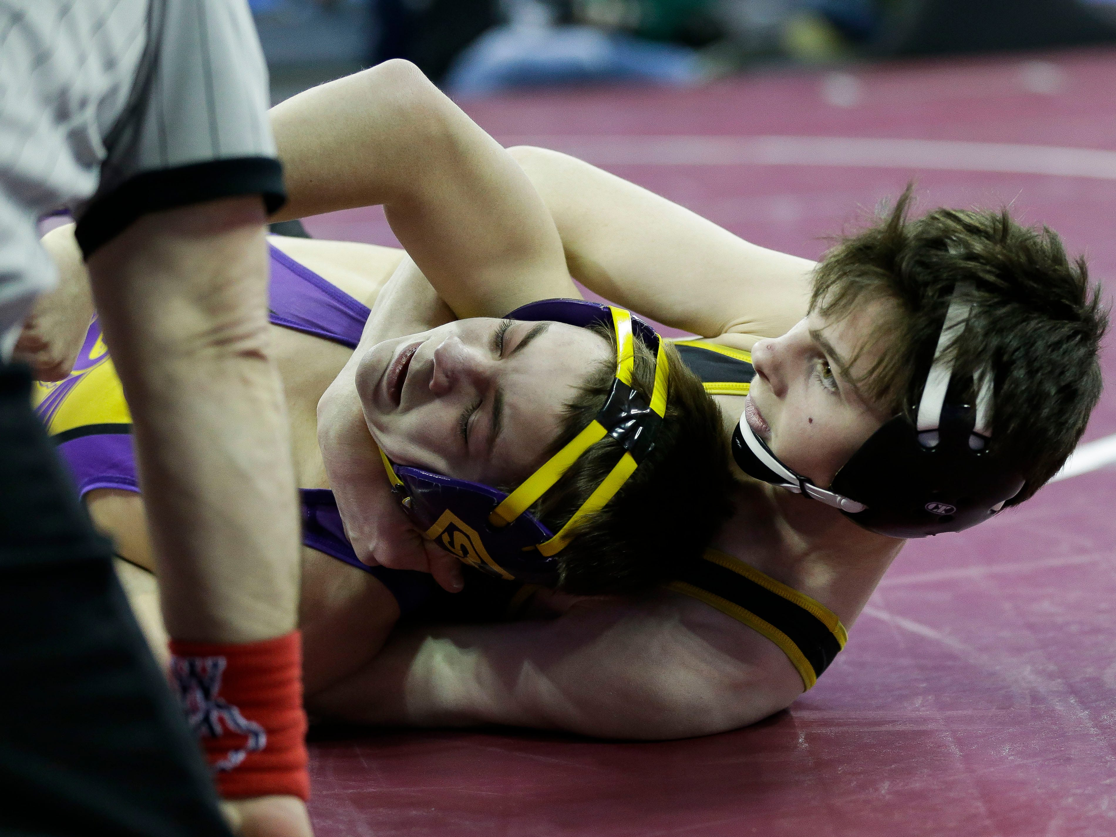 Sheboygan Falls' Cole Mattek is pinned by Northwestern's Markus Brown in a Division 2 113-pound preliminary match during the WIAA state wrestling tournament on Thursday, February 21, 2019, at the Kohl Center in Madison, Wis.