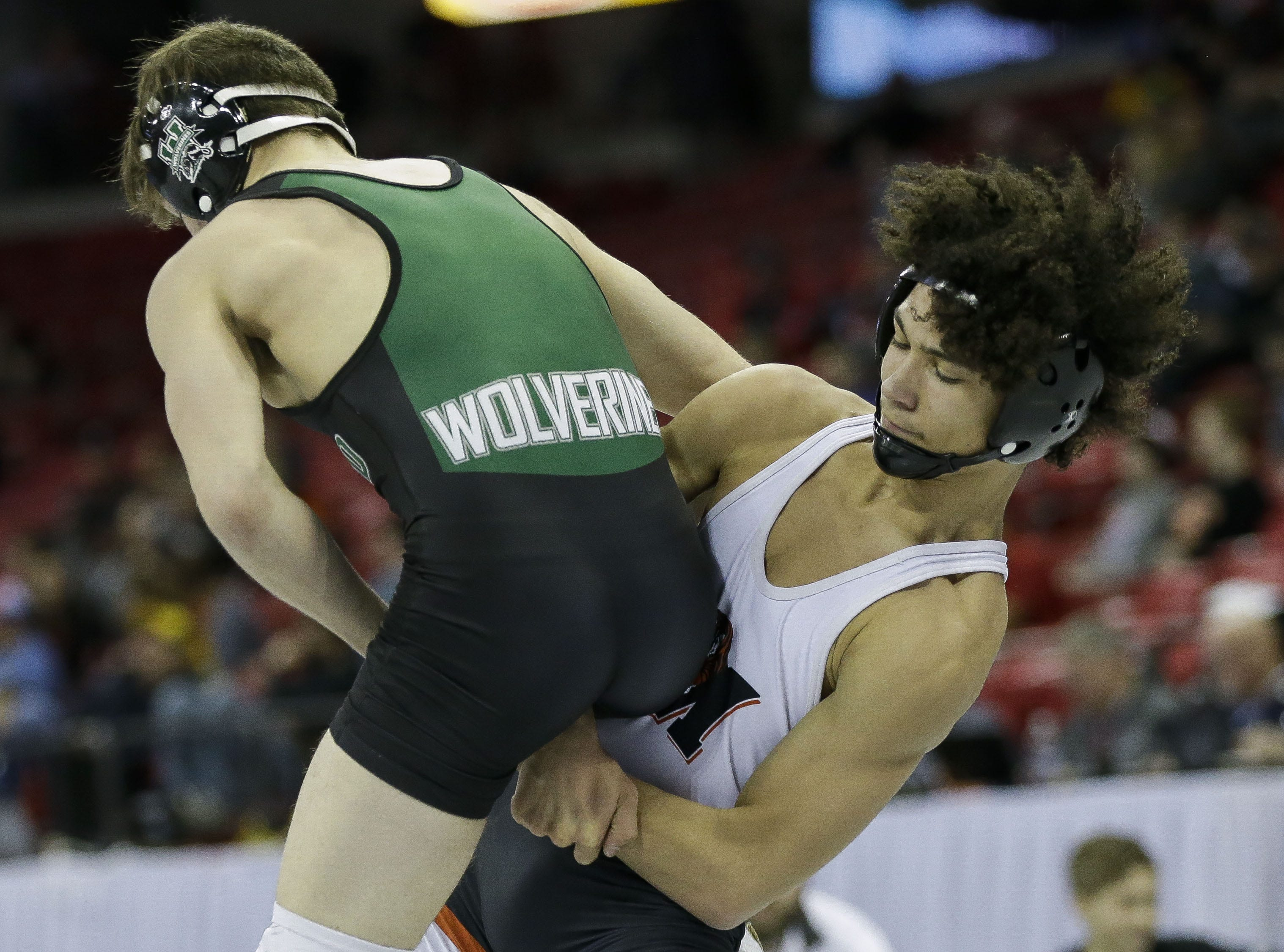 Marshfield's Gabe Pugh wrestles against Waterford's Joshua Cherba in a Division 1 126-pound preliminary match during the WIAA state wrestling tournament on Thursday, February 21, 2019, at the Kohl Center in Madison, Wis. Tork Mason/USA TODAY NETWORK-Wisconsin