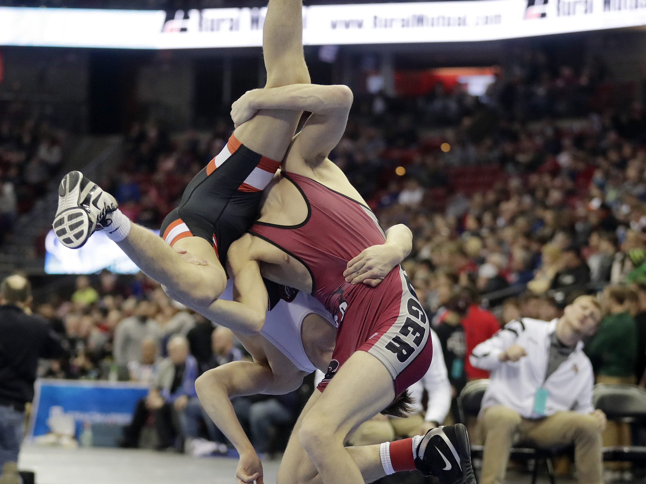 Marshfield's Shane Westerhausen wrestles Badger's Jake Striesky in a Division 1 120-pound preliminary match at the WIAA state individual wrestling tournament at the Kohl Center on Thursday, February 21, 2019 in Madison, Wis. Adam Wesley/USA TODAY NETWORK-Wisconsin