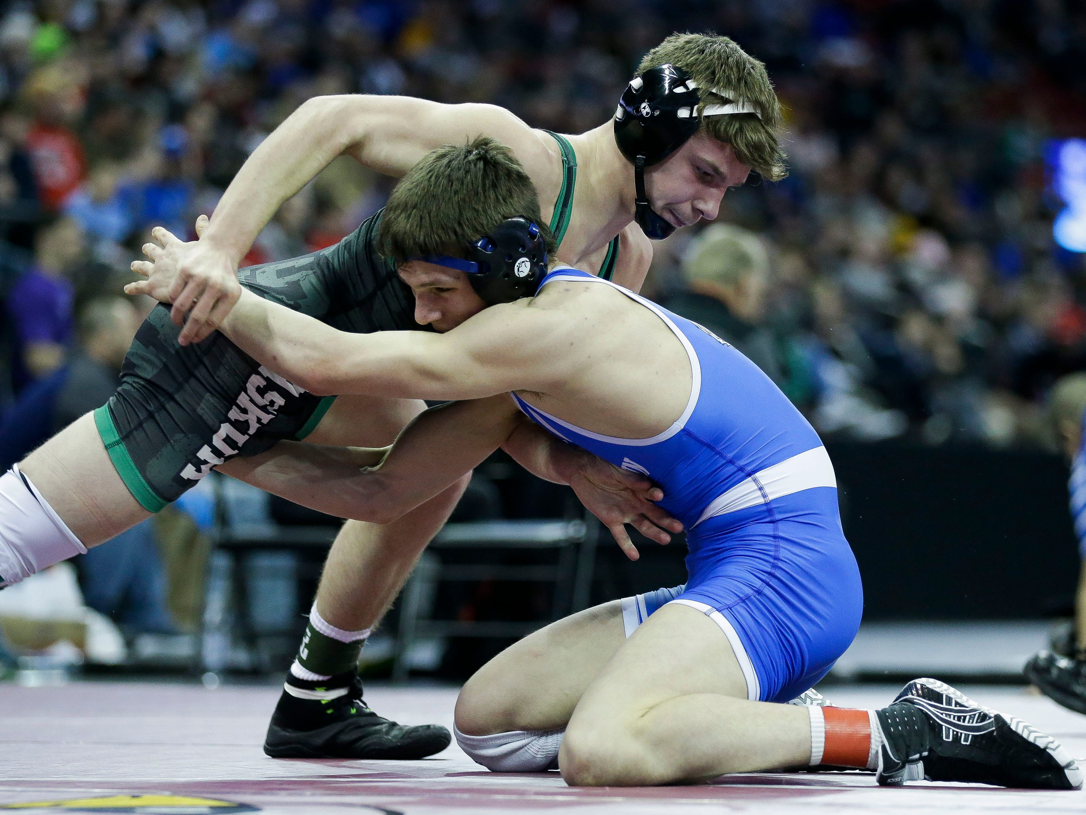 Wrightstown's Ben Durocher wrestles against Kewaskum's Braden Maertz in a Division 2 145-pound preliminary match during the WIAA state wrestling tournament on Thursday, February 21, 2019, at the Kohl Center in Madison, Wis.
