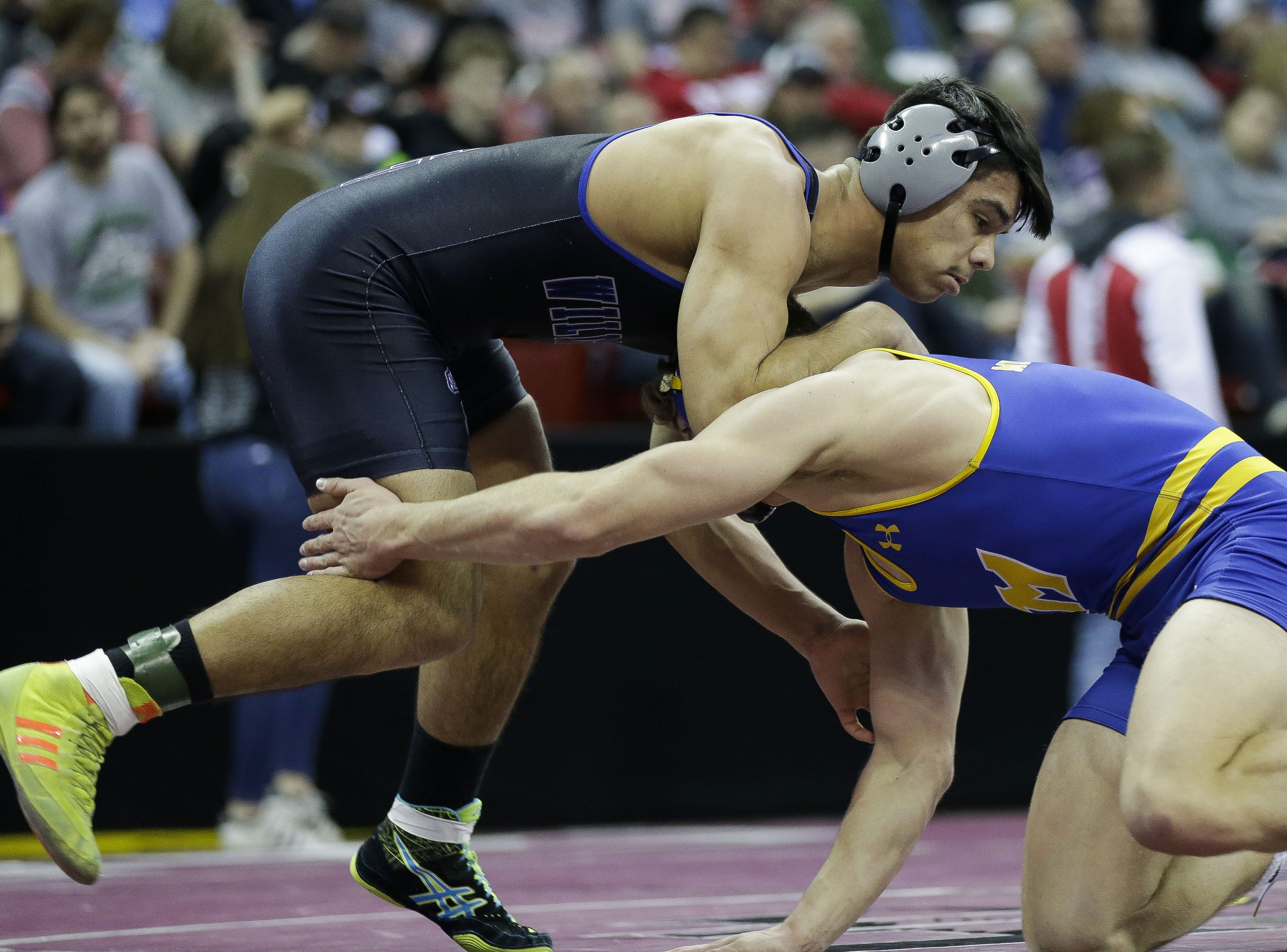 Oshkosh West's Edgar Heredia wrestles against Mukwonago's Aaron Schmitz in a Division 1 170-pound preliminary match during the WIAA state wrestling tournament on Thursday, February 21, 2019, at the Kohl Center in Madison, Wis. Tork Mason/USA TODAY NETWORK-Wisconsin