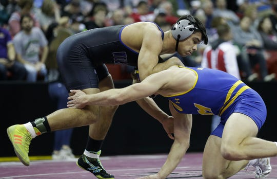 Oshkosh West's Edgar Heredia wrestles against Mukwonago's Aaron Schmitz in a Division 1 170-pound preliminary match Thursday during the WIAA state wrestling tournament at the Kohl Center in Madison. Heredia finished third.