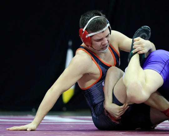 Oconto Falls' Clayton Whiting wrestles in a Division 2 152-pound quarterfinal match at the WIAA state individual wrestling tournament Friday at the Kohl Center in Madison.