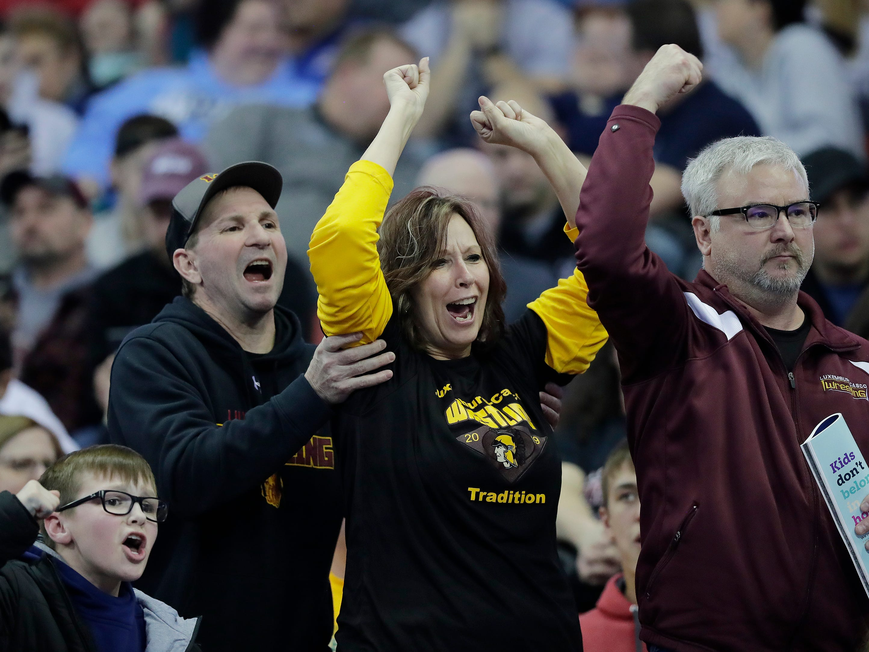 Luxemburg-Casco fans cheer during day 1 at the WIAA state individual wrestling tournament at the Kohl Center on Thursday, February 21, 2019 in Madison, Wis.