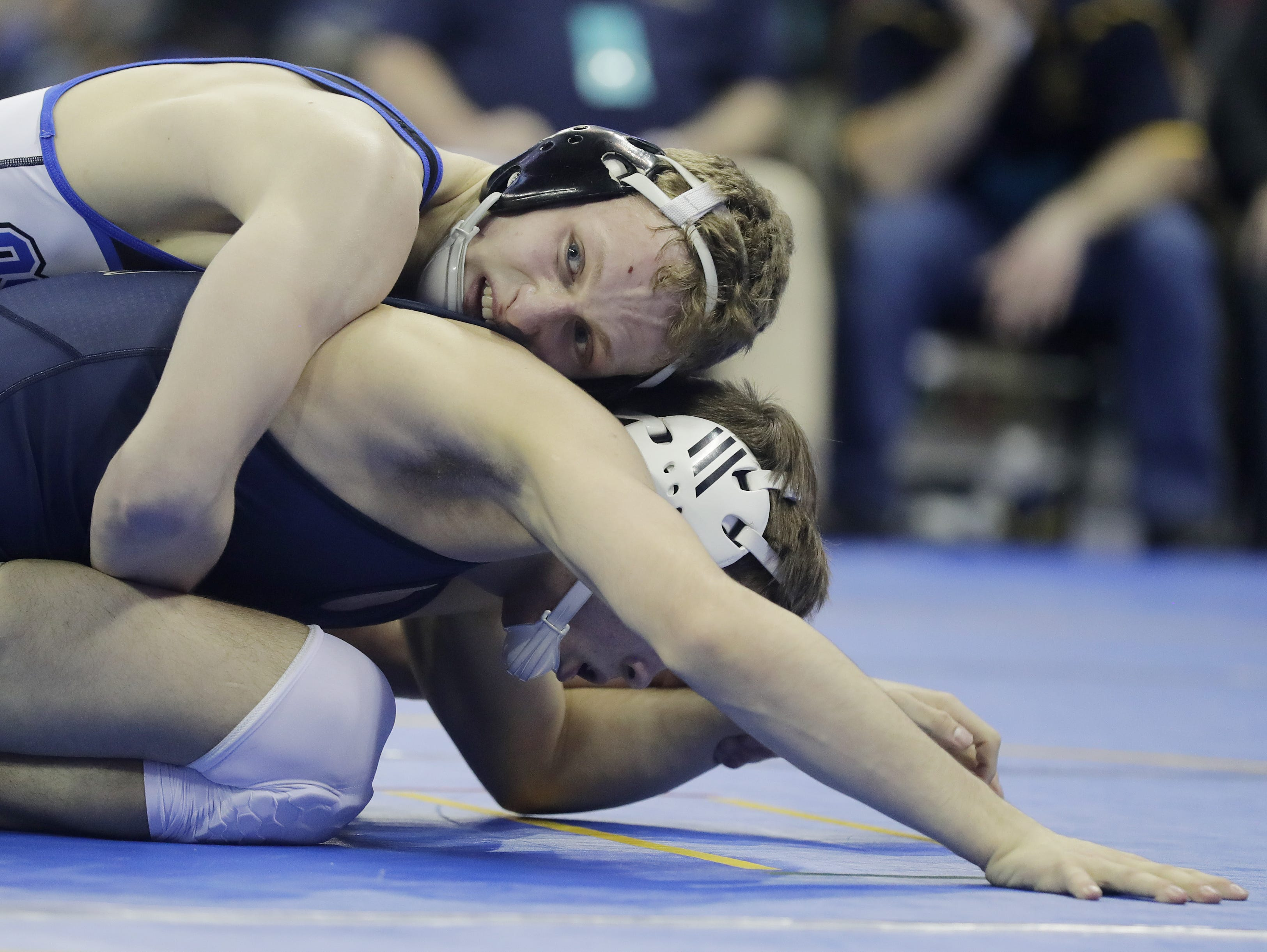 Oshkosh West's Logan Grota wrestles in a Division 1 132-pound preliminary match at the WIAA state individual wrestling tournament at the Kohl Center on Thursday, February 21, 2019 in Madison, Wis. Adam Wesley/USA TODAY NETWORK-Wisconsin