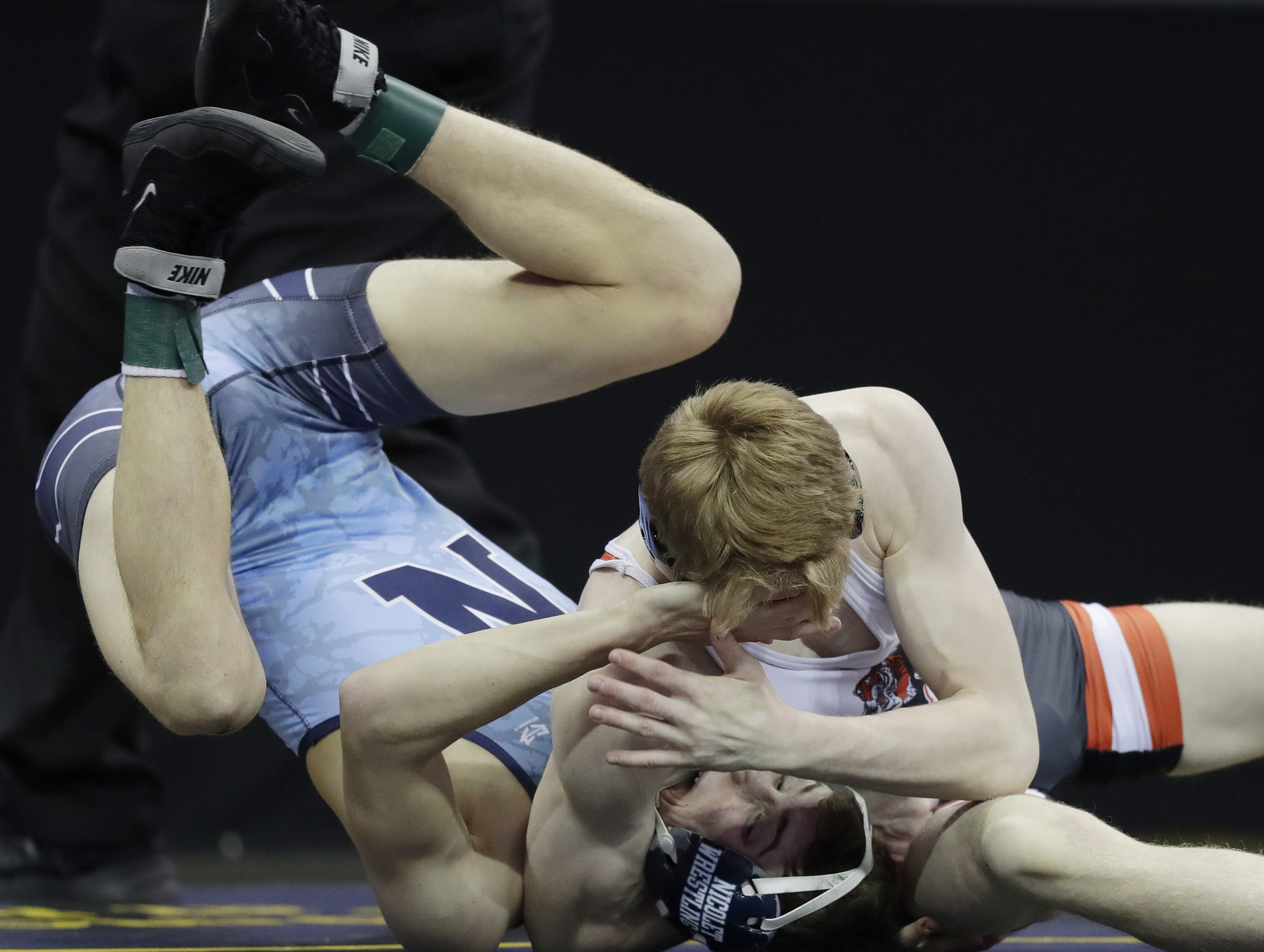 Marshfield's Ryan Dolezal wrestles Nicolet's Ryan Kuesel in a Division 1 132-pound preliminary match at the WIAA state individual wrestling tournament at the Kohl Center on Thursday, February 21, 2019 in Madison, Wis. Adam Wesley/USA TODAY NETWORK-Wisconsin