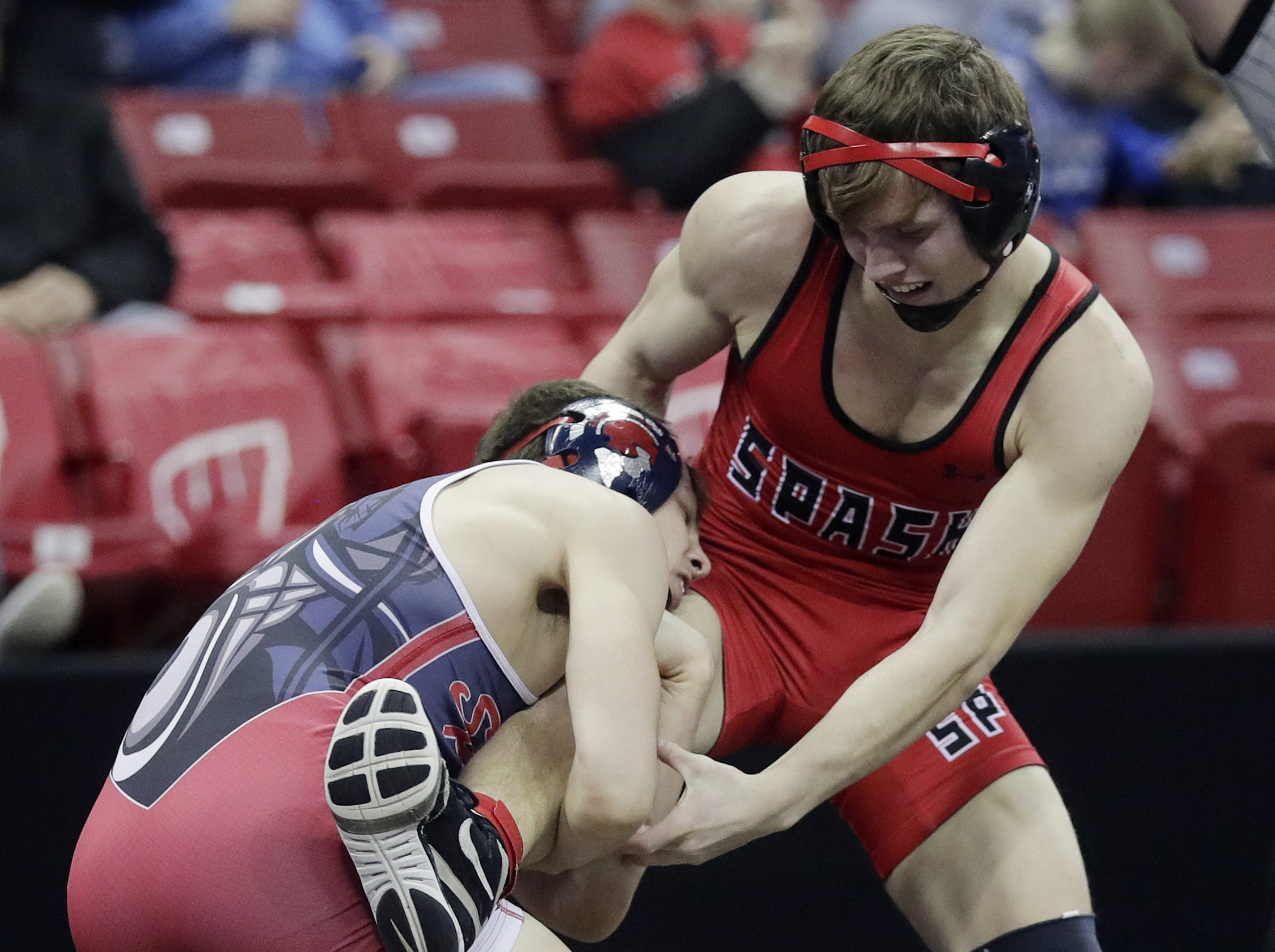 SPASH's Max Schierl wrestles in a Division 1 132-pound preliminary match at the WIAA state individual wrestling tournament at the Kohl Center on Thursday, February 21, 2019 in Madison, Wis. Adam Wesley/USA TODAY NETWORK-Wisconsin