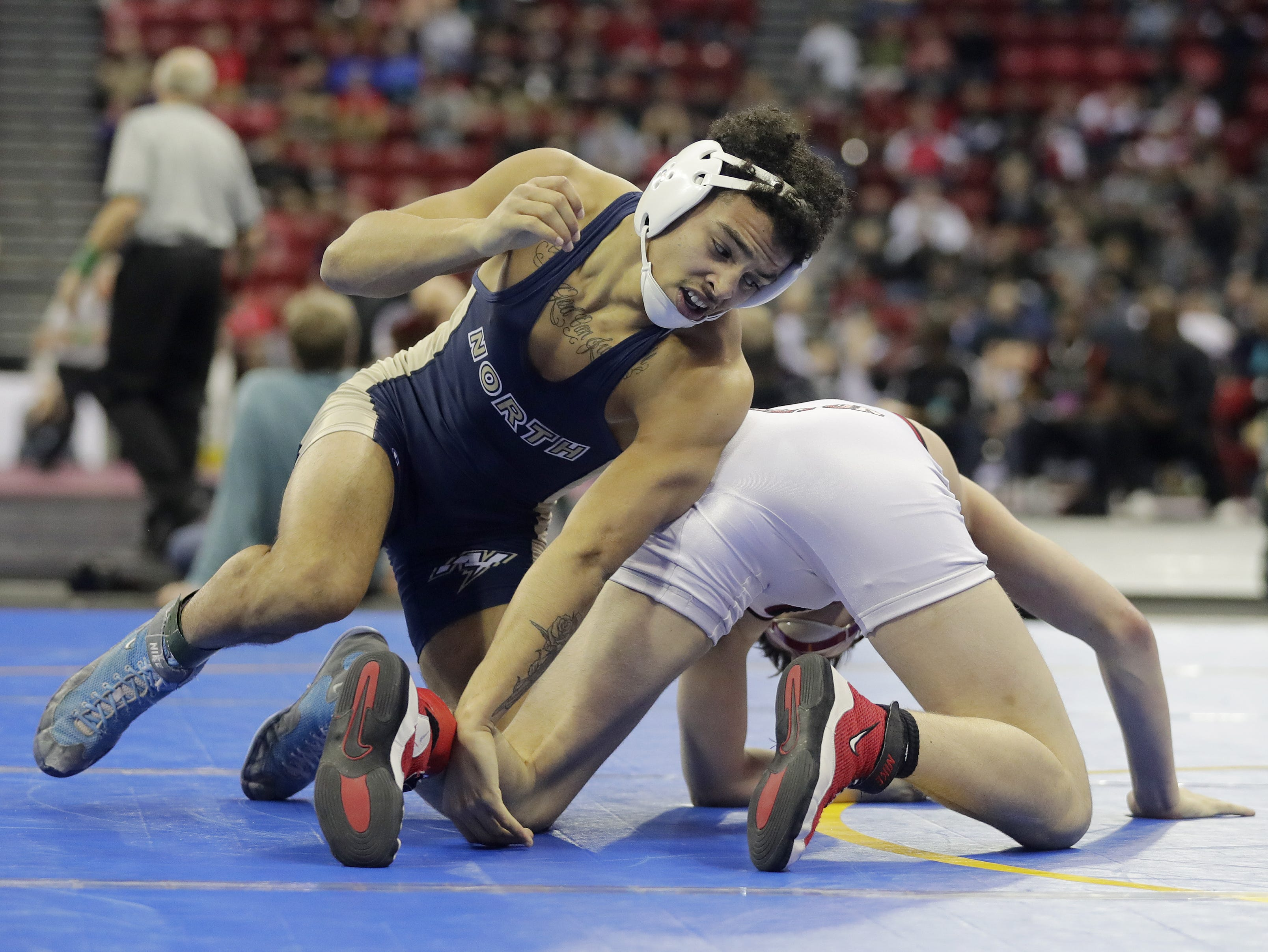 Appleton North's Terrell Williams wrestles in a Division 1 195-pound preliminary match at the WIAA state individual wrestling tournament at the Kohl Center on Thursday, February 21, 2019 in Madison, Wis. Adam Wesley/USA TODAY NETWORK-Wisconsin