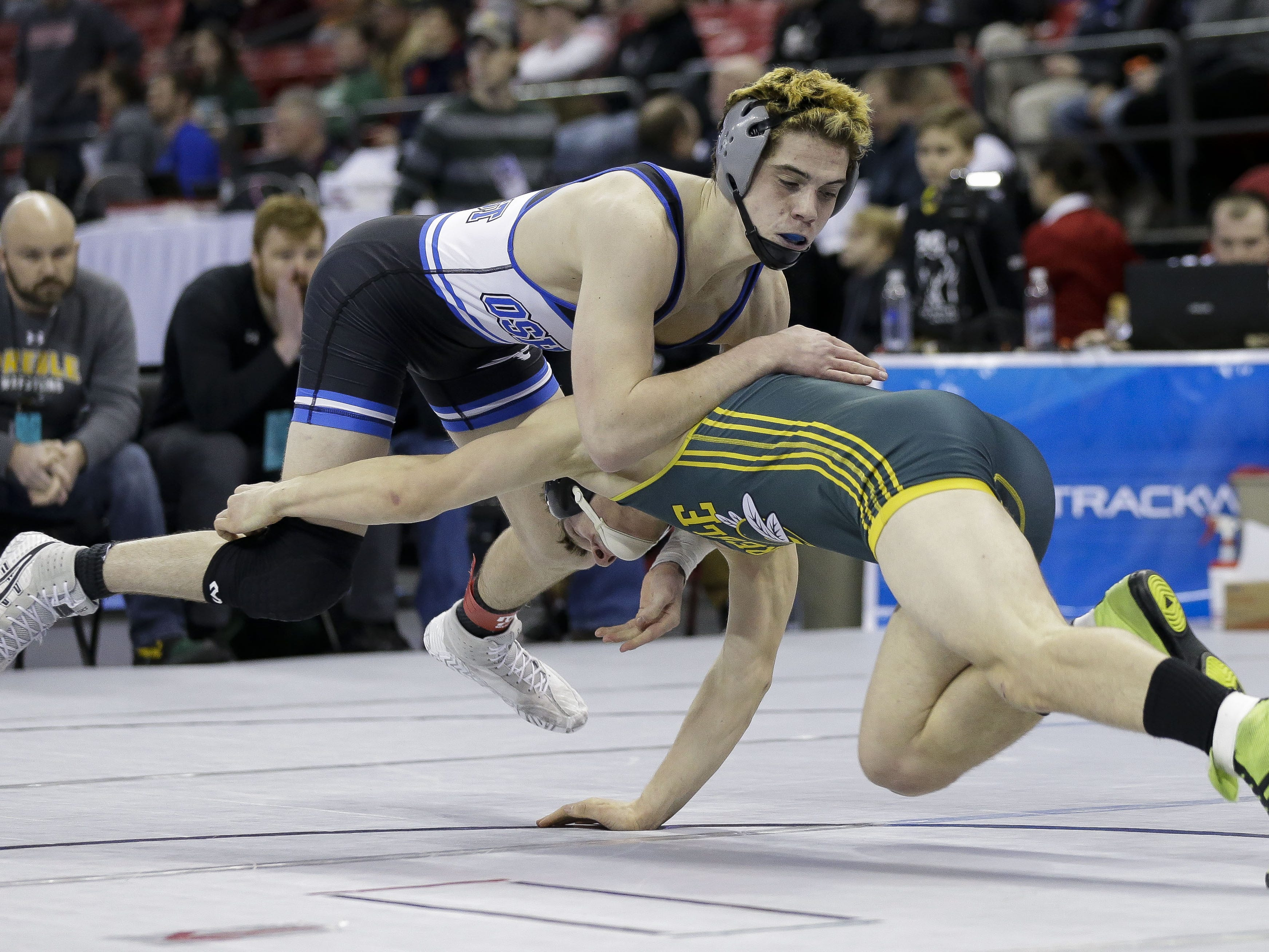 Oshkosh West's Connor Collins scrambles to avoid a take down against Green Bay Preble's Kade Cummings in a Division 1 152-pound preliminary match during the WIAA state wrestling tournament on Thursday, February 21, 2019, at the Kohl Center in Madison, Wis. Tork Mason/USA TODAY NETWORK-Wisconsin