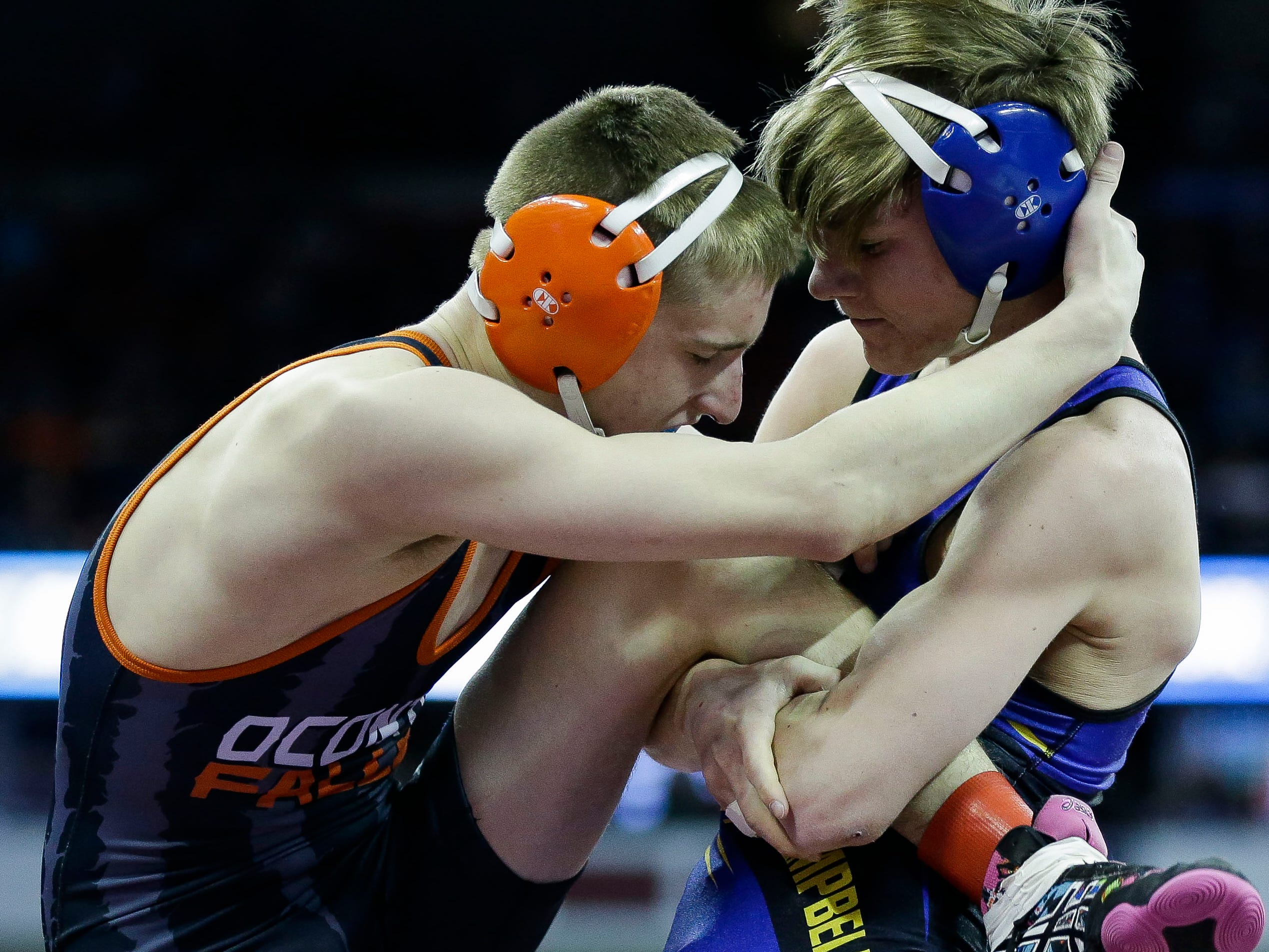 Elkhart Lake-Glenbeulah/Howards Grove's Cody Rebedew works to take down Oconto Falls' Tyler Budz in a Division 2 126-pound preliminary match during the WIAA state wrestling tournament on Thursday, February 21, 2019, at the Kohl Center in Madison, Wis.
