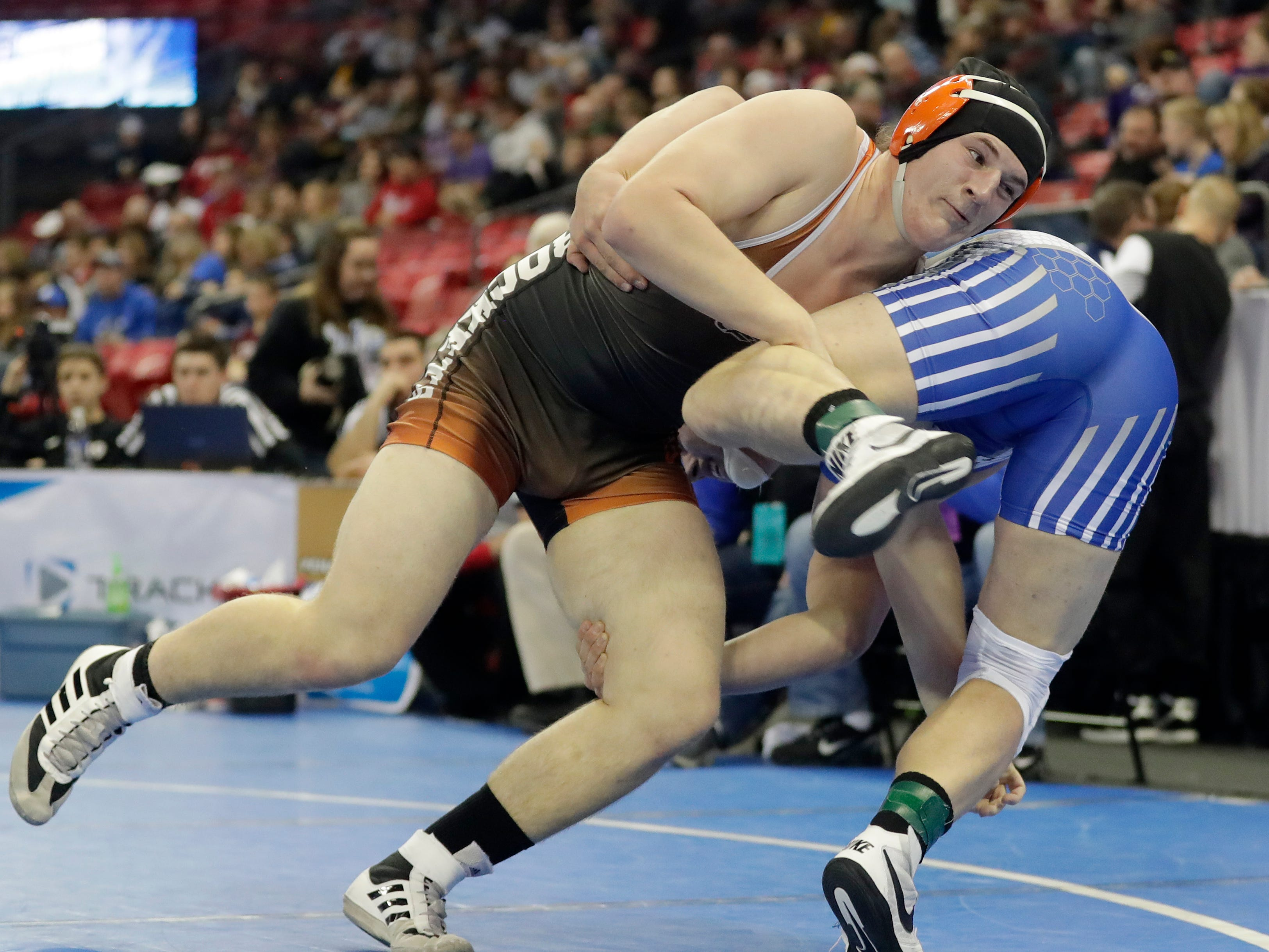 Cedar Grove-Belgium's Brett Feind wrestles in a Division 3 220-pound preliminary match at the WIAA state individual wrestling tournament at the Kohl Center on Thursday, February 21, 2019 in Madison, Wis.