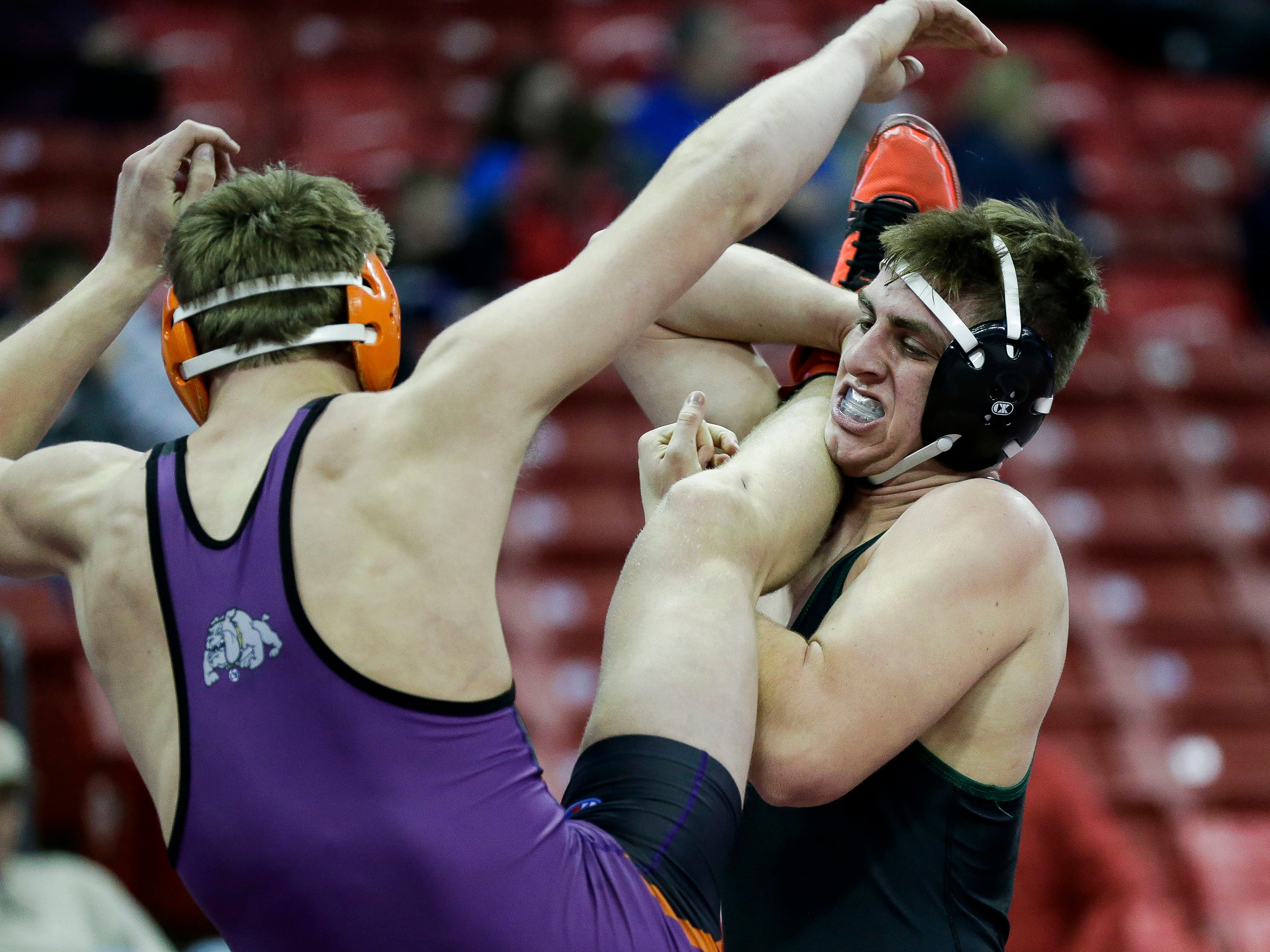 Berlin's C.J. Kurczek works to take down C-W/PF's Justis Knutson in a Division 2 195-pound preliminary match during the WIAA state wrestling tournament on Thursday, February 21, 2019, at the Kohl Center in Madison, Wis.