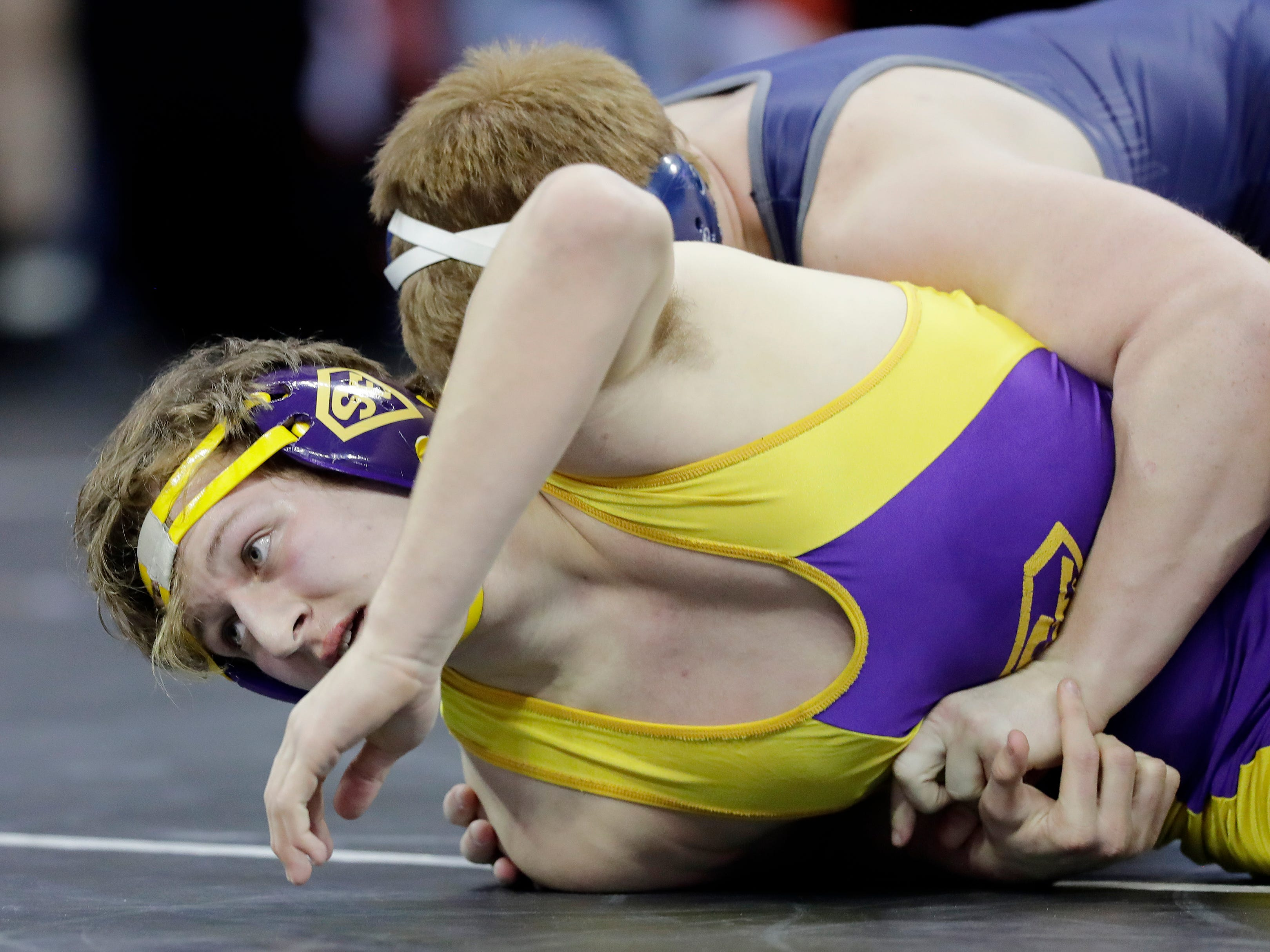 Sheboygan Falls' Connor Pierce wrestles in a Division 2 220-pound preliminary match at the WIAA state individual wrestling tournament at the Kohl Center on Thursday, February 21, 2019 in Madison, Wis.